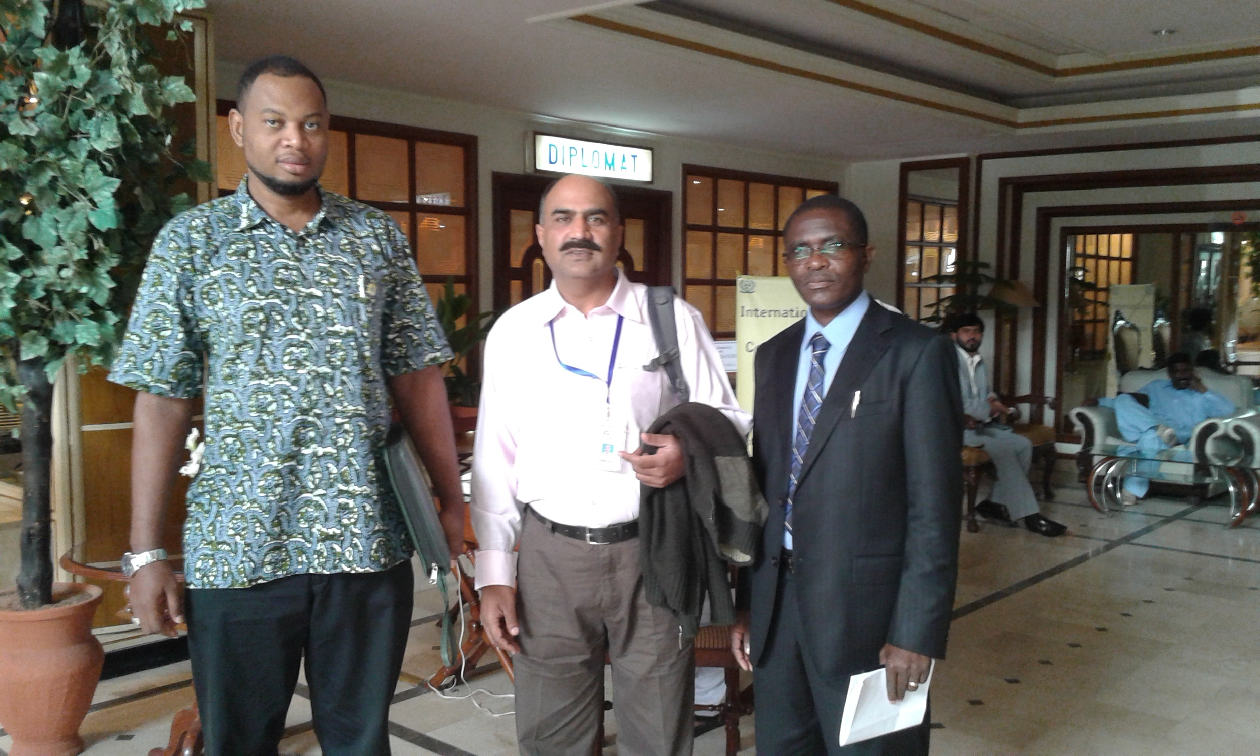 HCR's Hazeen Latif withGabriel (left) and Juma Shamte (right), conference delegates from Tanzania.
