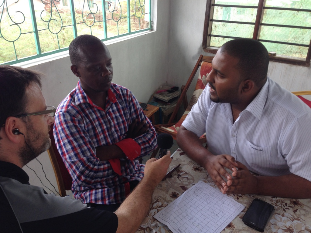 Tana FM's Shedrack Hiribae interviews Dr Badru Mohaji, Director of Special Programmes and Cohesion, about Tana River County's flood preparations, with support from HCR's Alex Stout.