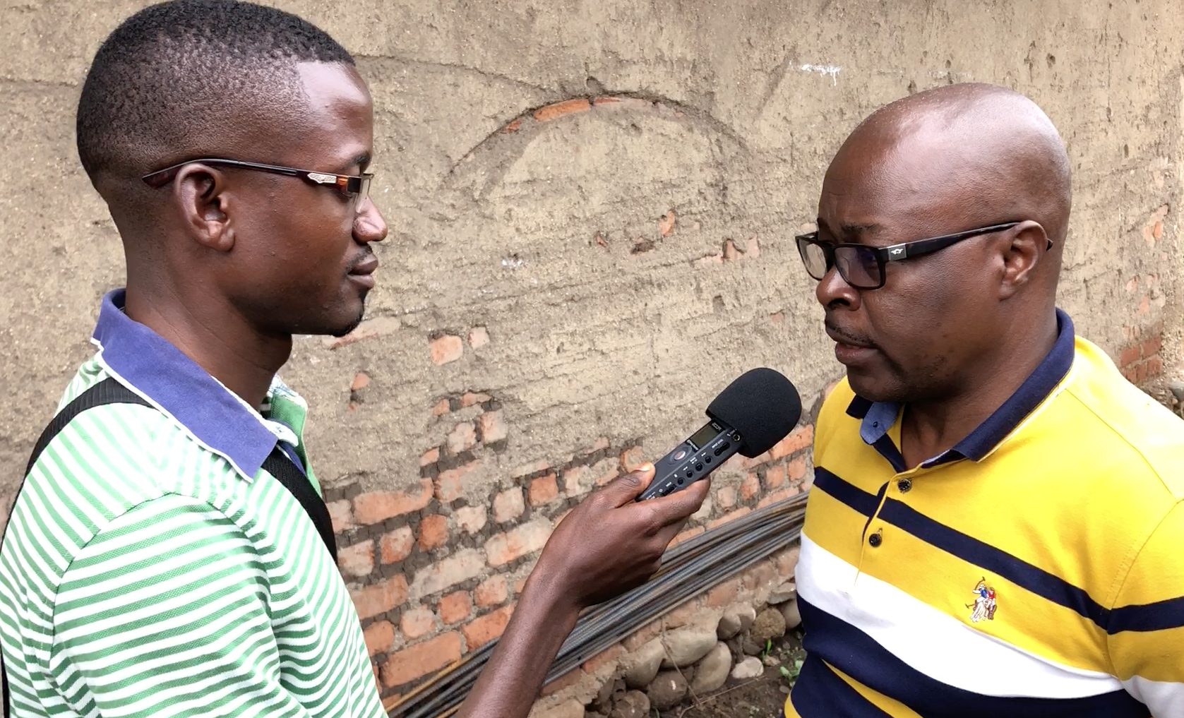 Hon Albert Baliesima, MP for Beni Territory being interviewed by Baraka Bacweki from Umoja FM in Nobili
