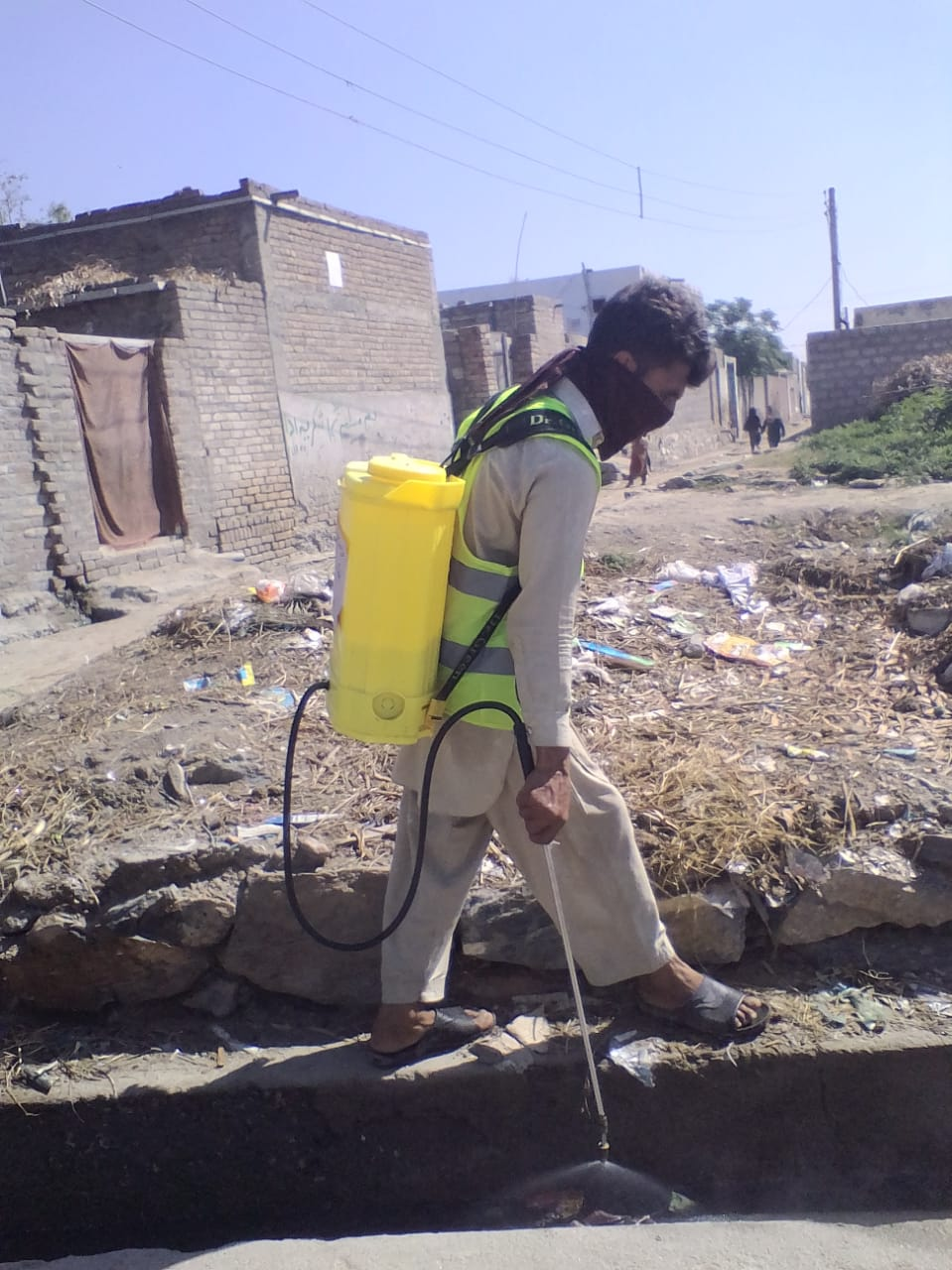 NSCSG volunteer spraying gutters in Majukay