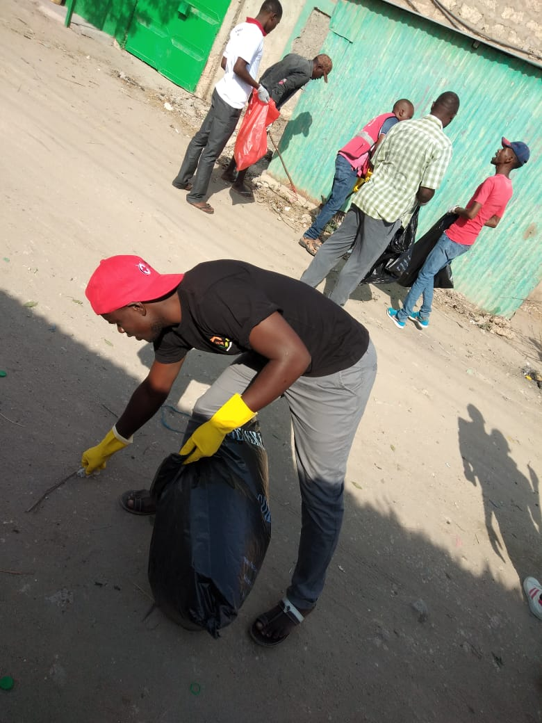 Amani FM presenters, Red Cross workers and youth join together to clean up their town in Tana River County