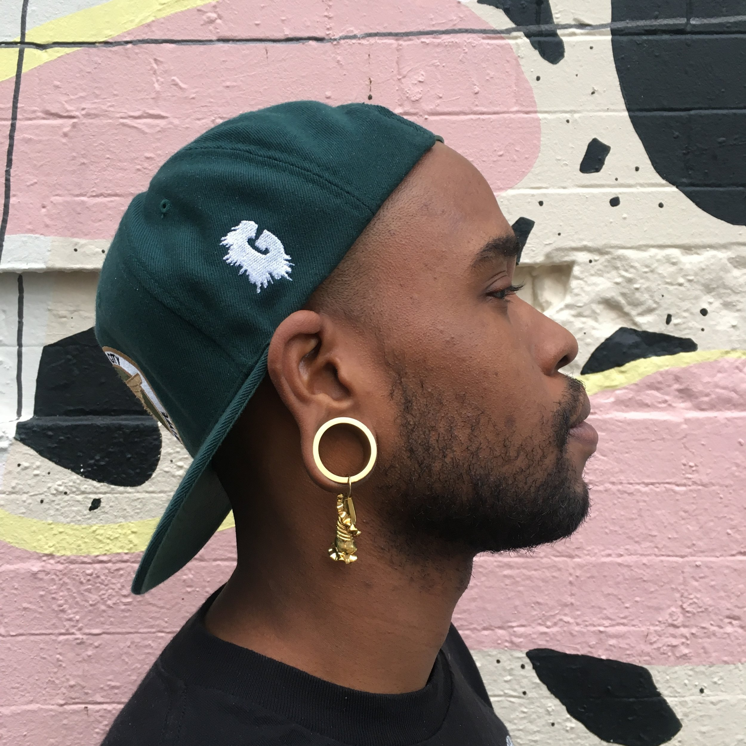 Campanella Earrings  worn this way or your way. Gold. Made in Manhattan. Modeled by  Derti the Ripper . It takes an East Village. THX ( Boris &  Horton , Ave. A @ 12th Street)