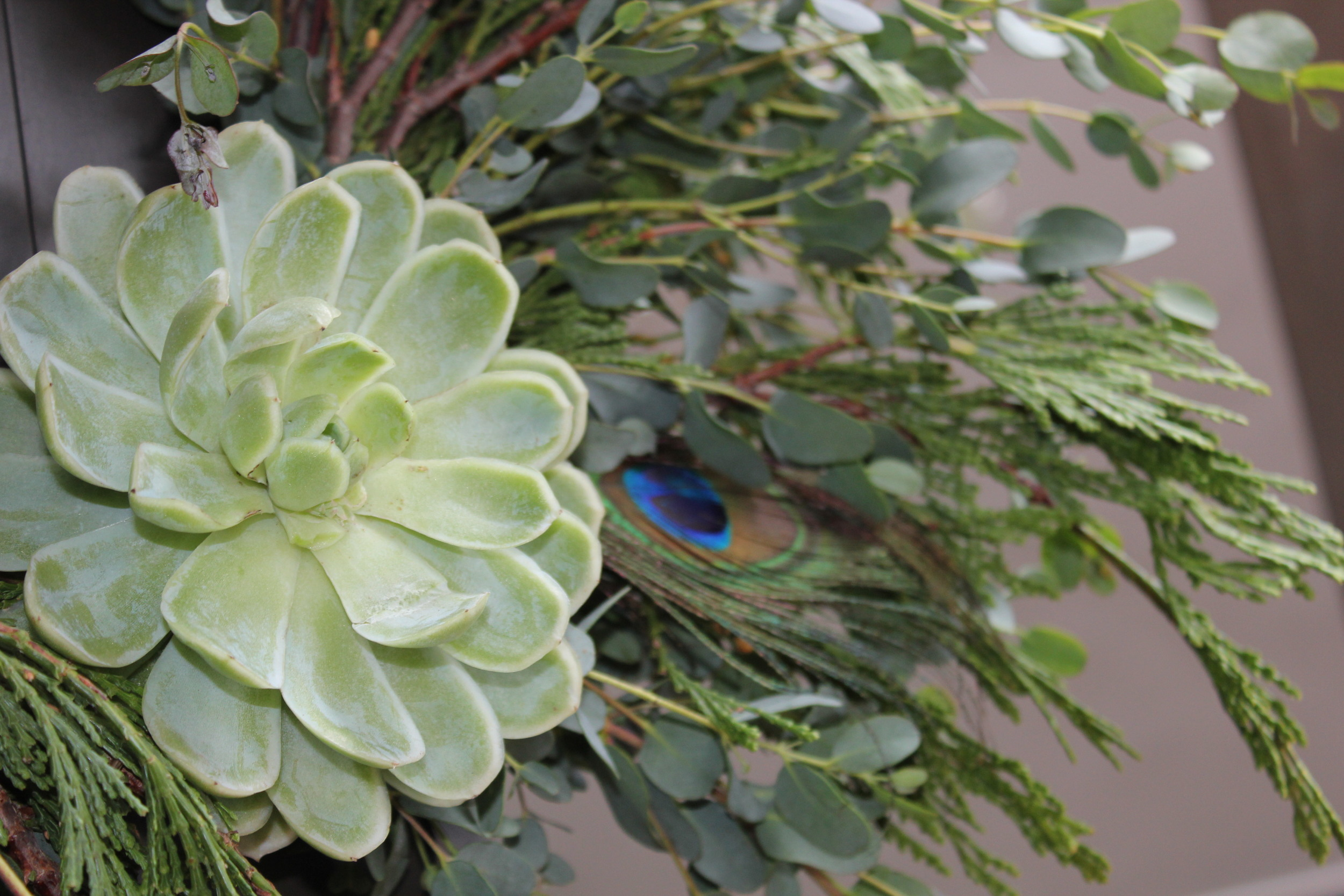 Sometimes the embellishments are small touches of succulents and feathers.