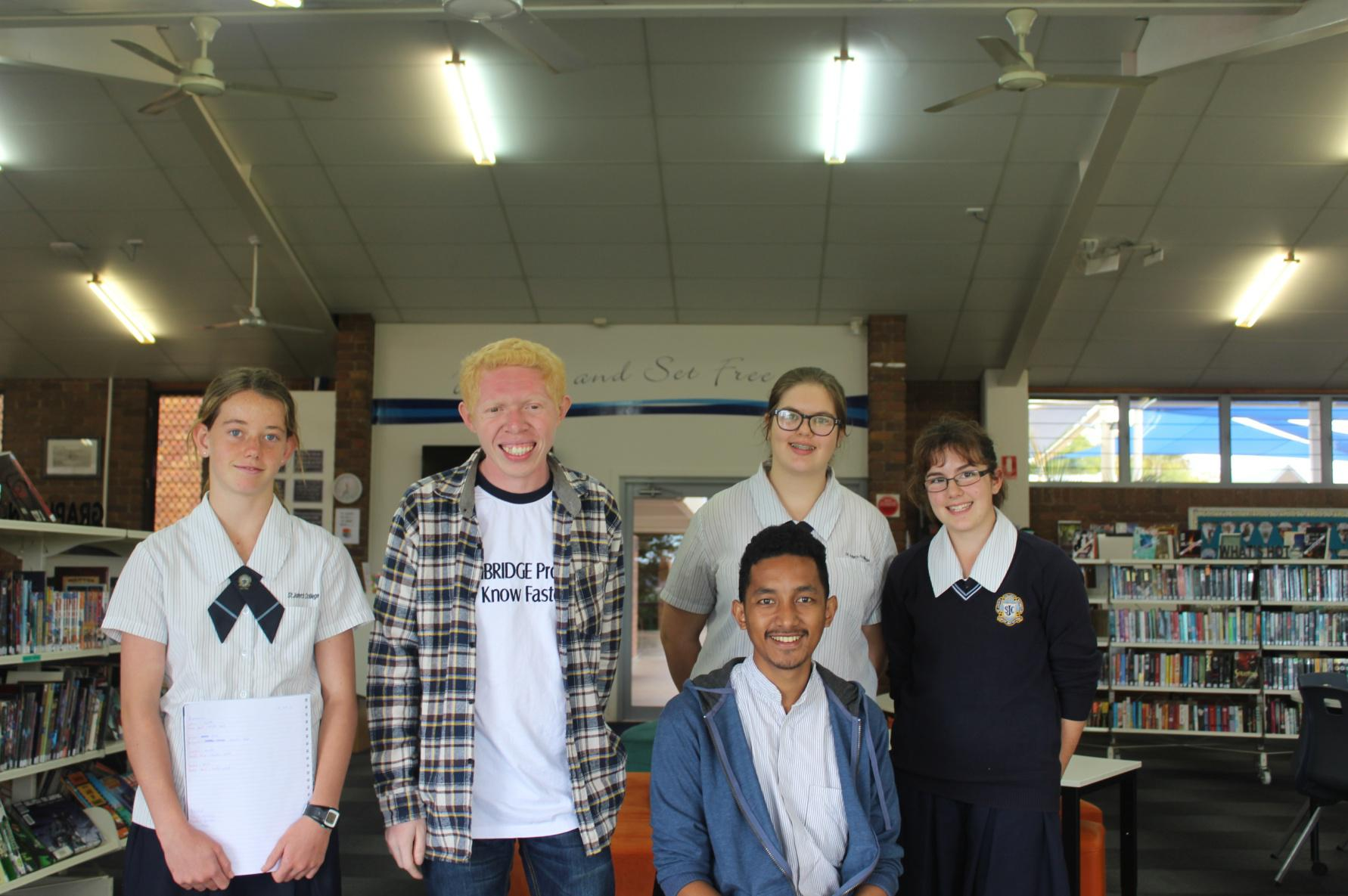 Taking picture at the library with the student of John's Collage when they showing around of the school to us.