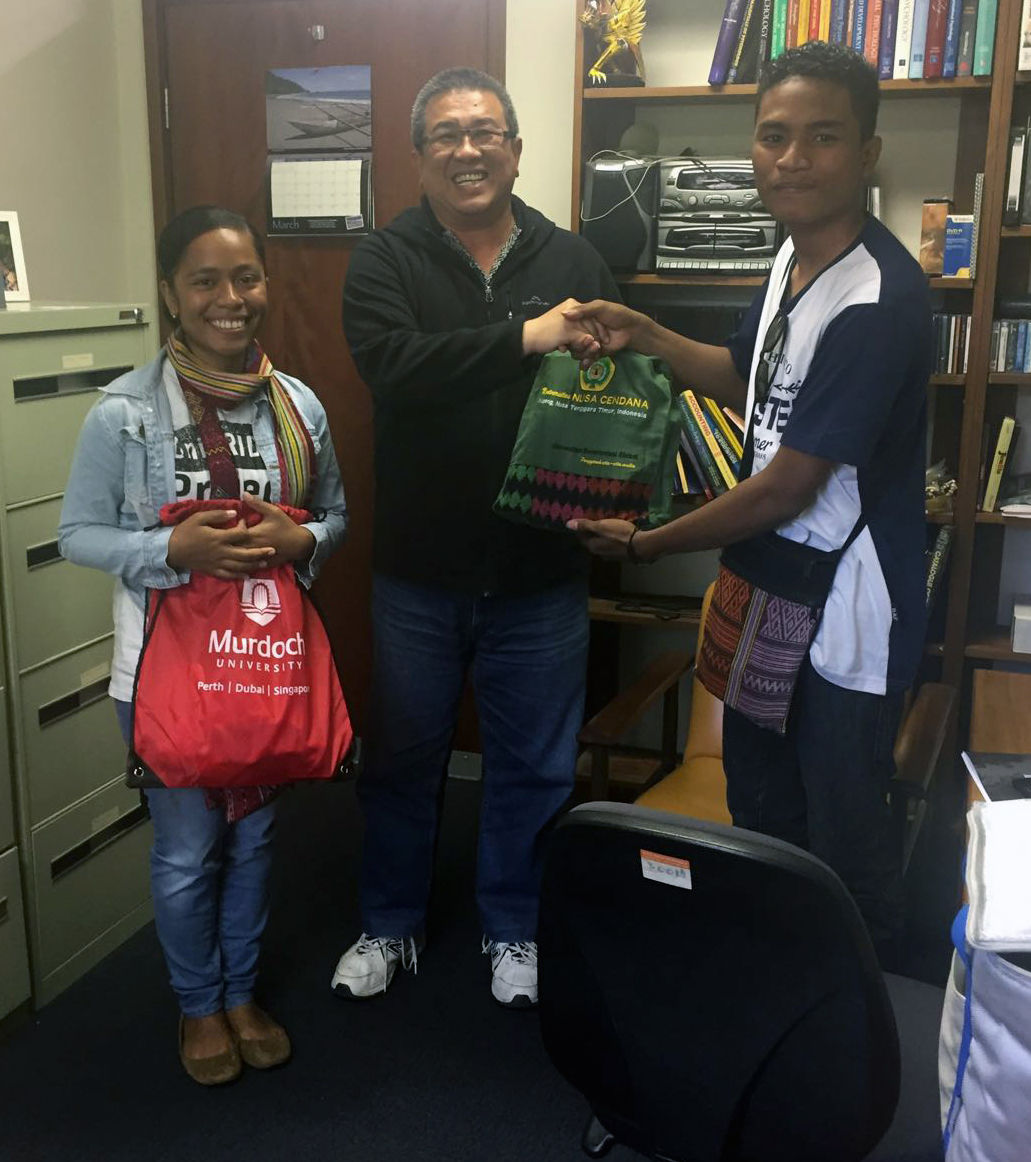 Exchanging gifts with Pak Irianto at Murdoch University in Perth