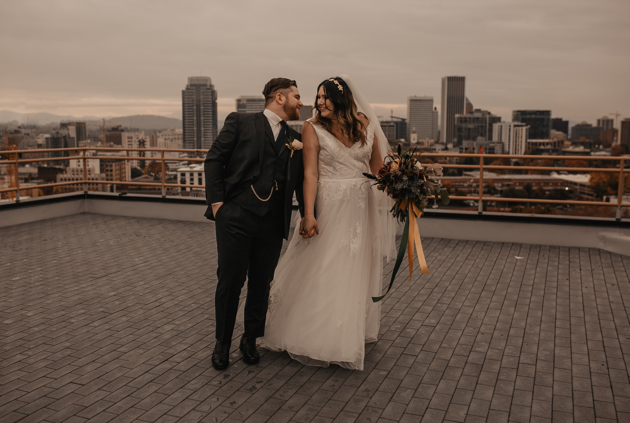 downtown portland rooftop first look on wedding day