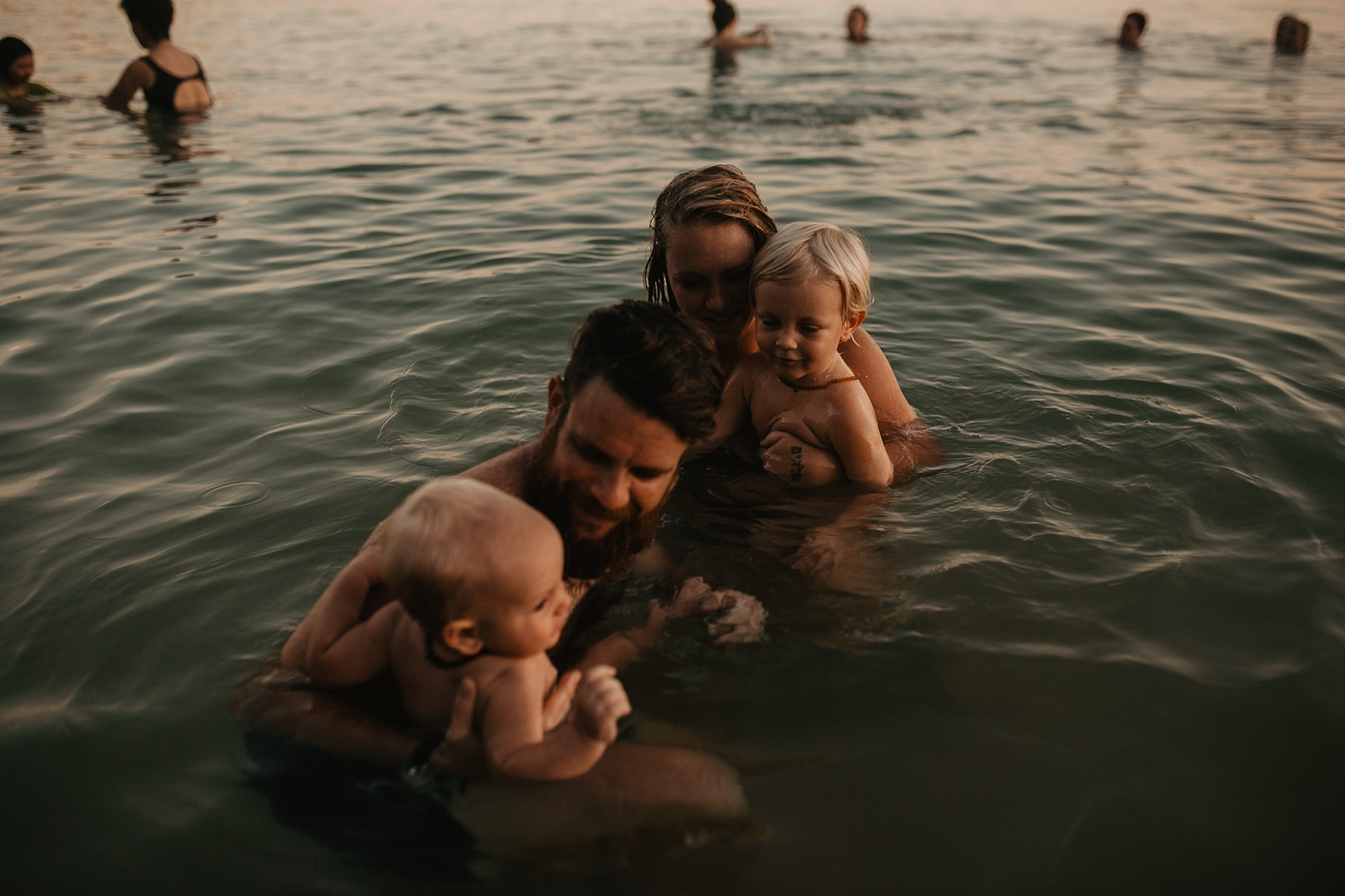 Family swim session in a Phuket Thailand private bay.