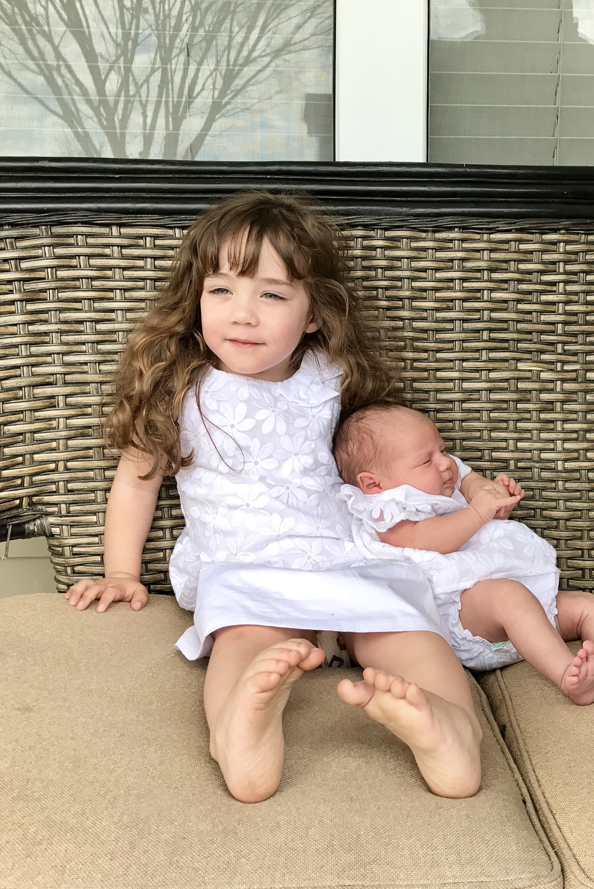 Tennessee with her new baby sister Ember. She is a great big sister.
