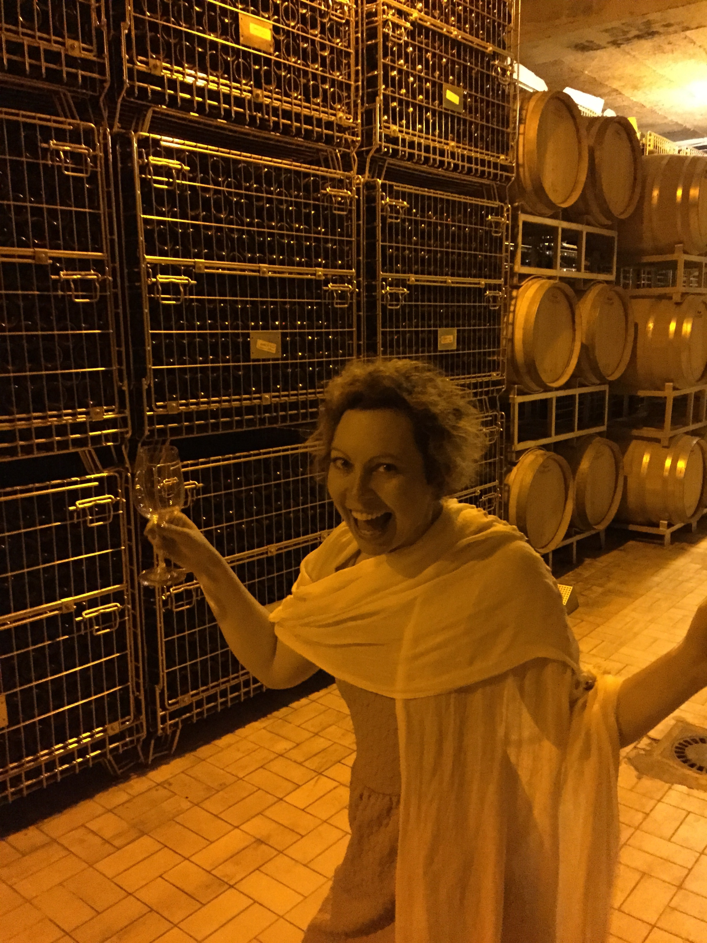 Kristin was excited to be in the cool, dark cellar after the heat outside.