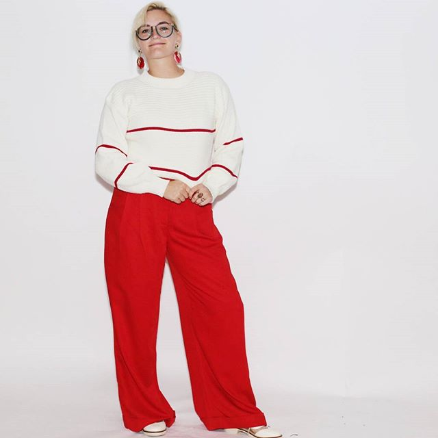 """For our first look, we have a casual yet seafaring-friendly outfit that says """"Welcome to the ribbon cutting for my latest addition to my fleet of jetskits...care for a highball?"""" Link in bio for more red-panted goodness! \\#vintage sweater, #thirfted earrings, pants via @rackkandruin_ and shoes via @kelsidaggerbrooklyn"""