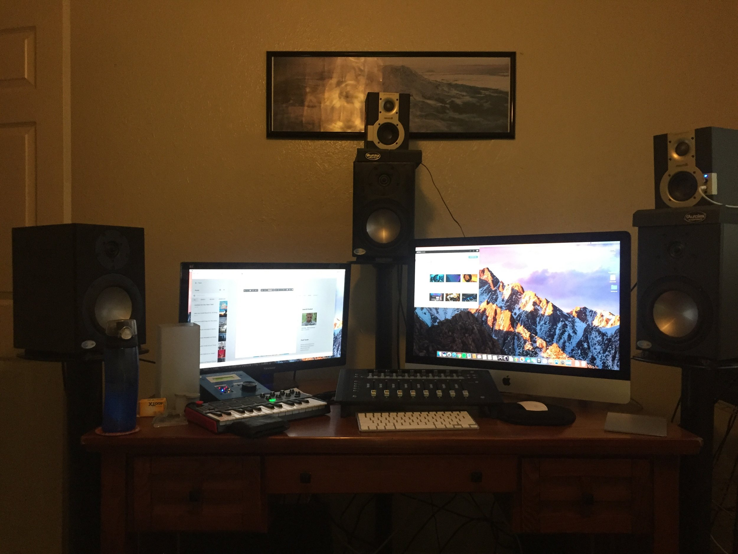 27 inch iMac, Akai MPK mini Keyboard, Avid Artist Mixer, 3 monitors up front by Blue Sky Audio, and 2 small listening back Samson Media One 3as (temporarily placed).  Not shown 2 JBLs for Left Surround and Right Surround and a monster UBL sub woofer.