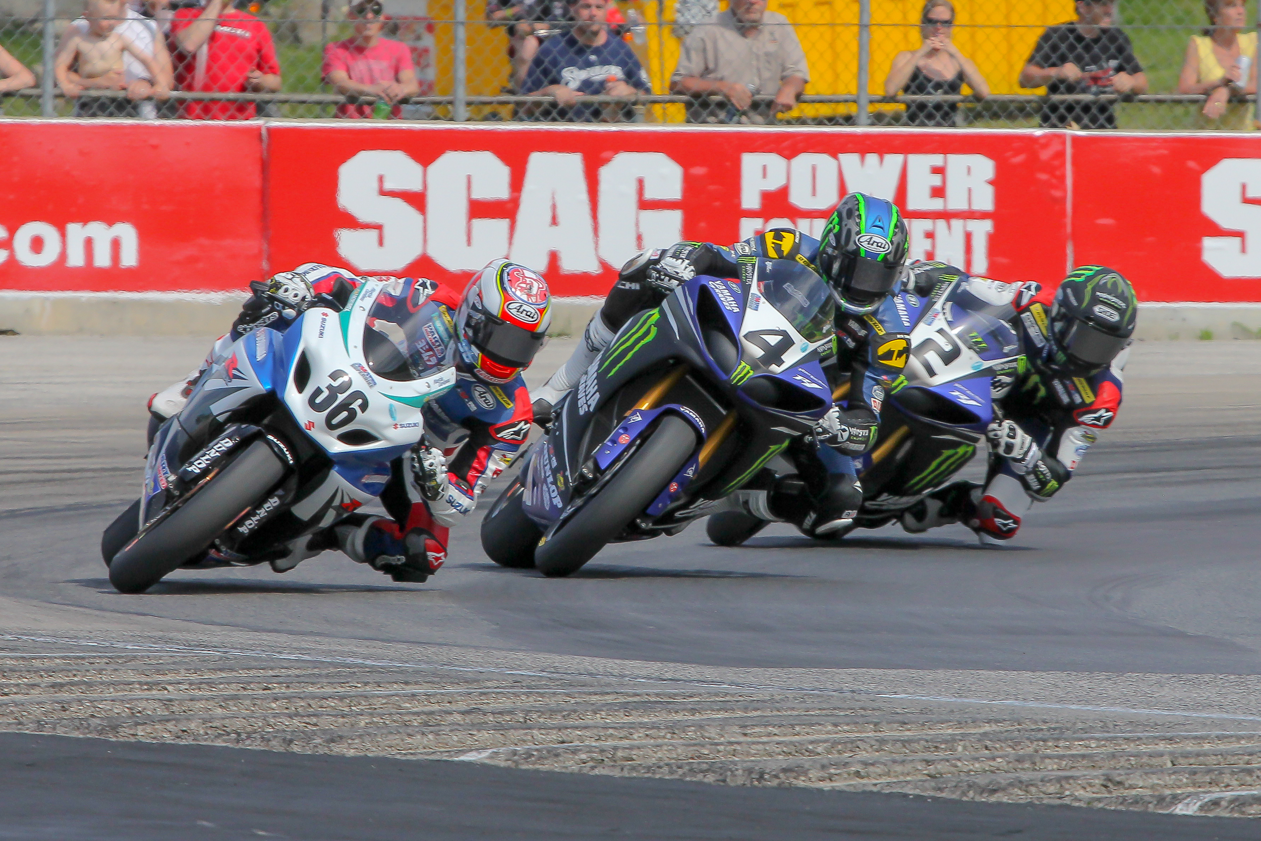 Battle between #36 Cardenas leading in first lap coming out of Turn 5 being pressured by #4 Hayes and #2 Beaubier
