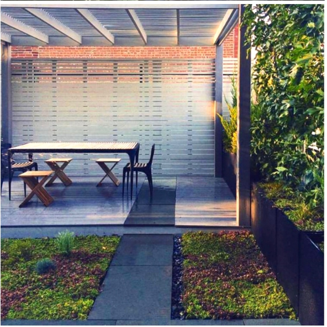 Green roof and garden on the 2nd floor, with several seating & dining areas, shade pergola, and screening from the street.
