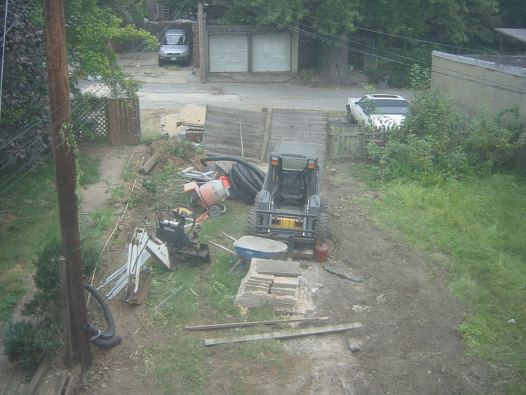 Before photo of the townhome backyard (Day 1 of demolition)