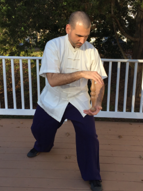 Dr. McCann practicing Six Harmonies movement with the Taiji Ruler