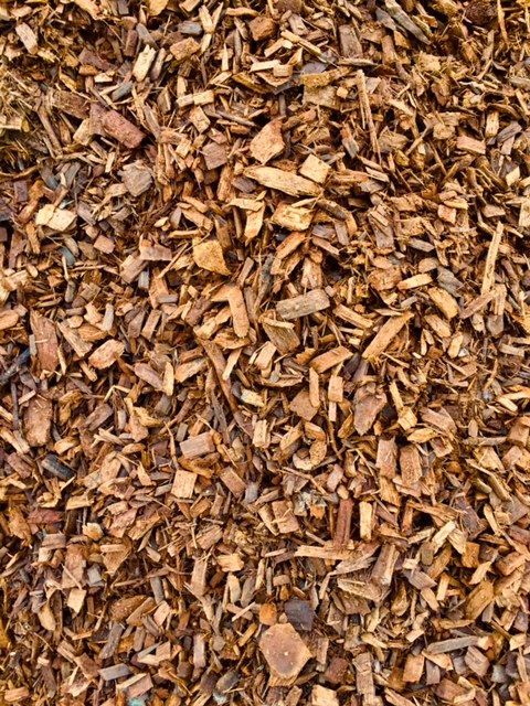 FOREST BROWN CHIPS  $45 per cubic yard One of the three chipped mulches Lawn-Corps processes for a more manicured look to your landscaping. Organically dyed and processed. Colorants used are environmentally safe and non-toxic for children, pets and plants.