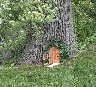 A fairy house tucked away at the base of a tree. I've seen a wide variety available for sale on Etsy.