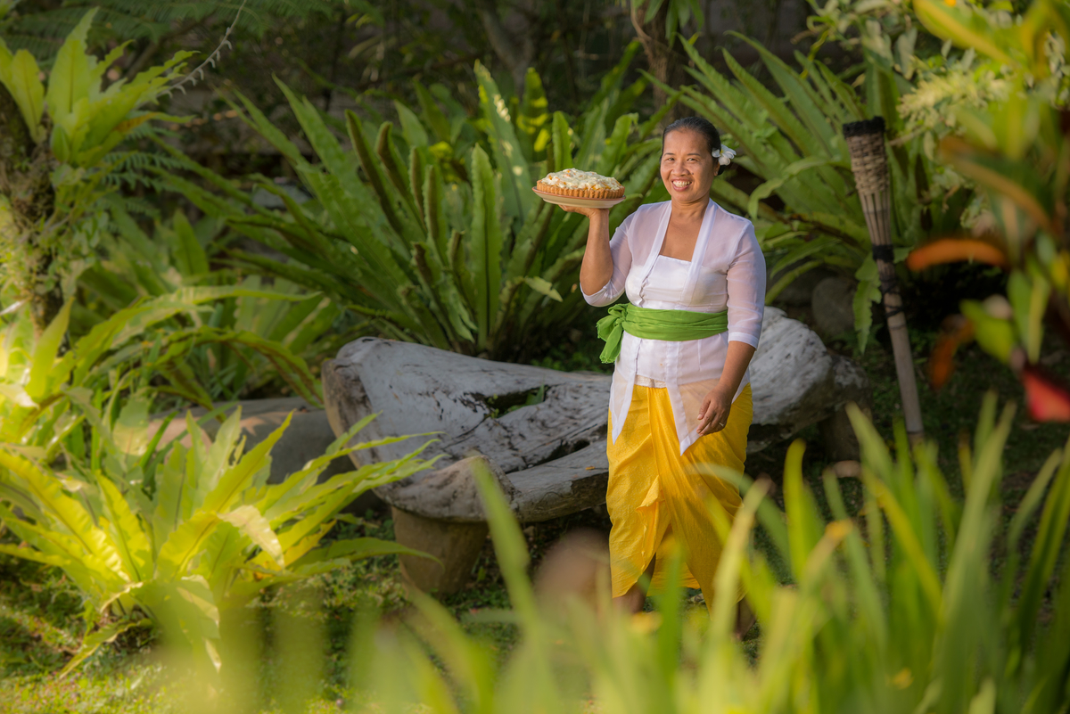 Nyoman Carries Mango Pie In Garden-Hartland-Estate.jpg
