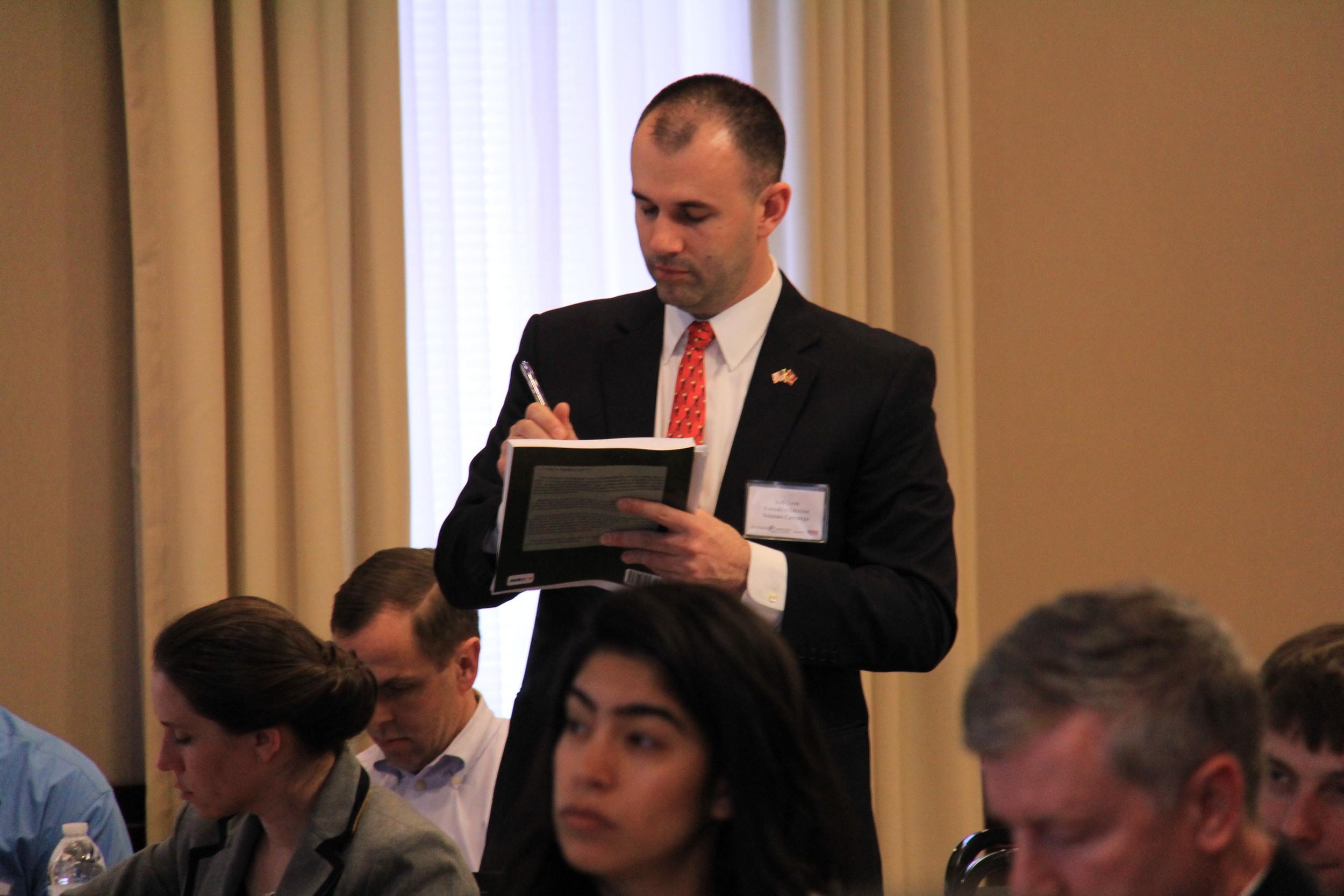 Executive Director of Veterans Campaign Seth Lynn preparing notes