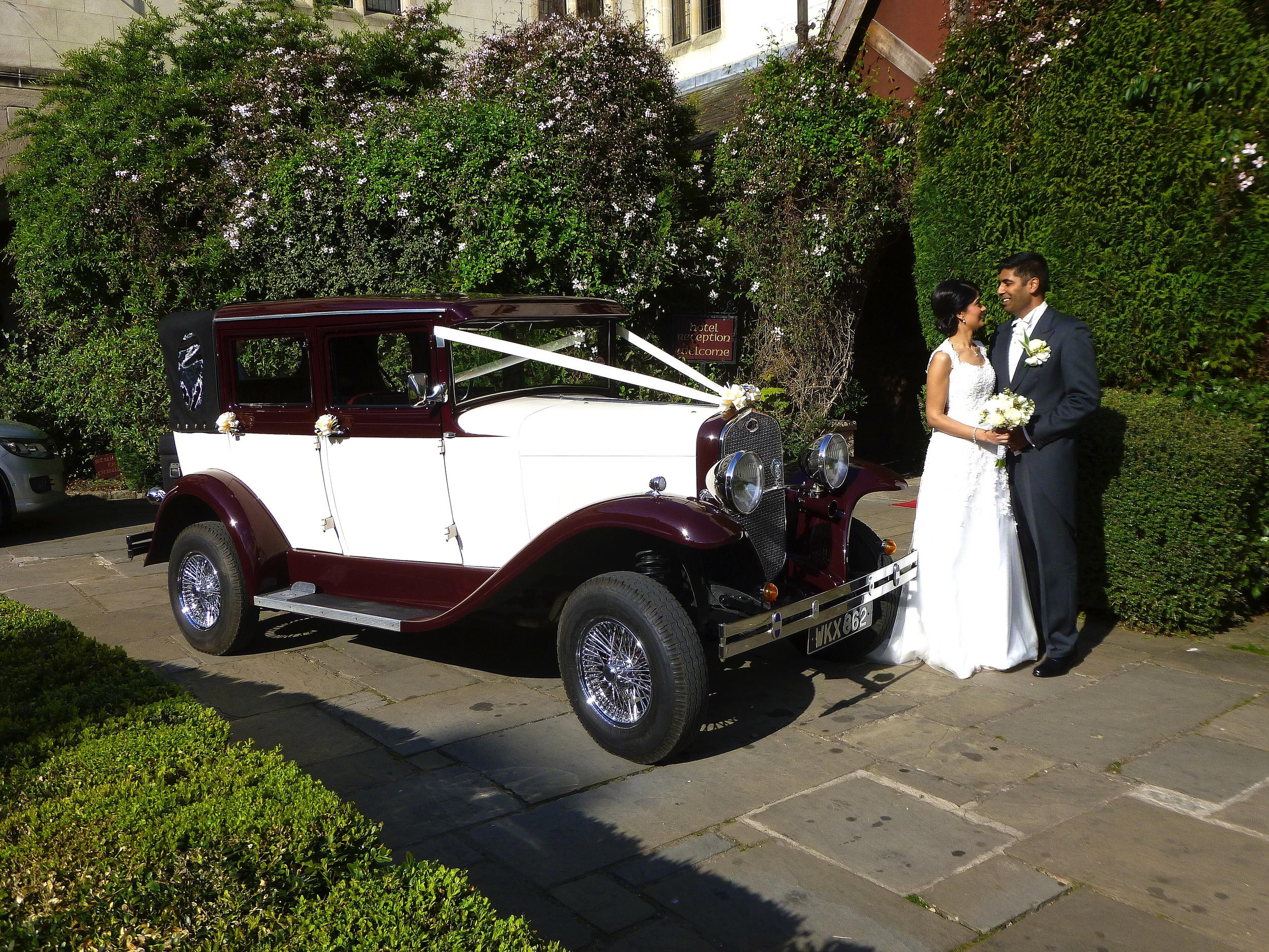 "The happy couple pose for some photographs with the Badsworth Landaulette prior to following a ""country"" route back to Leicester."