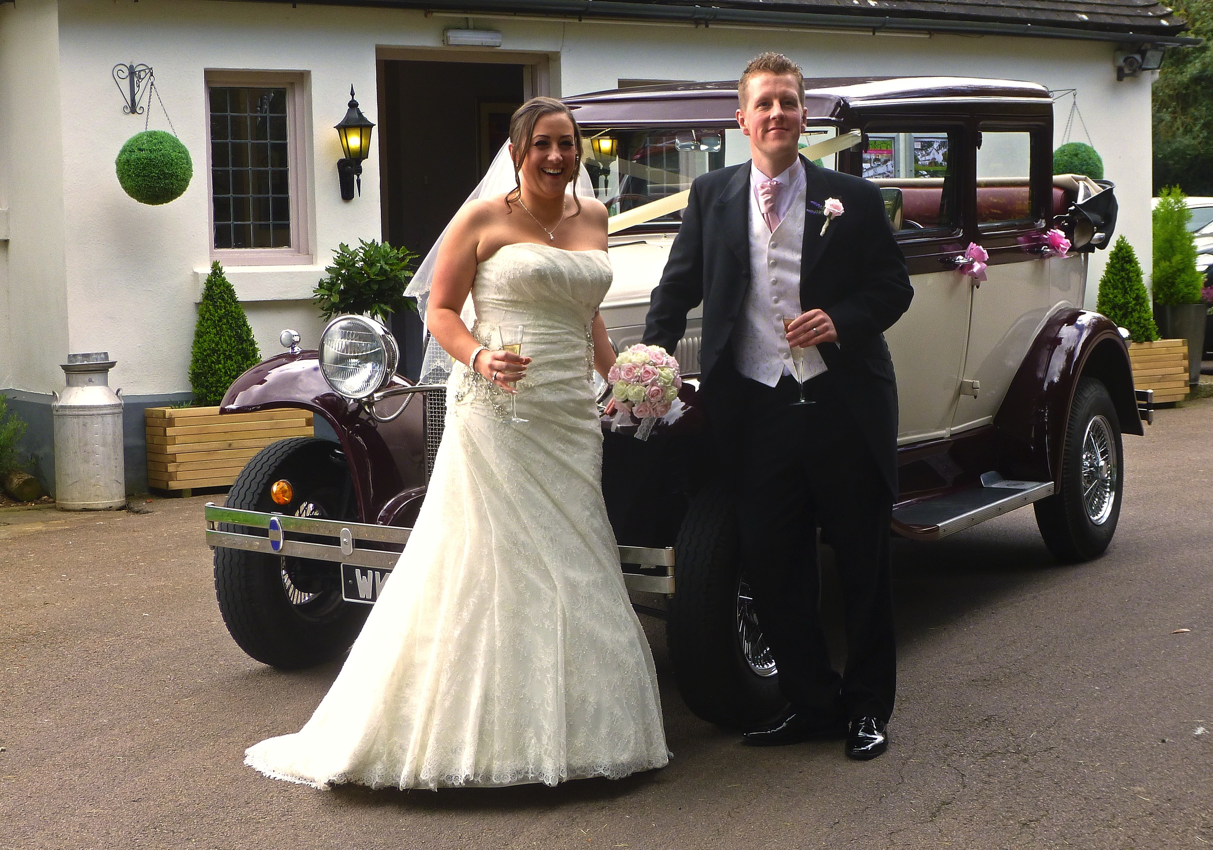 Carlene And Matthew enjoying a toast on arrival at Ashton Lodge Country House. The venue is close to the villages of Monks Kirby, Pailton, Withybrook, Street Ashton and Stetton under Fosse. A beautiful country setting for a wedding.