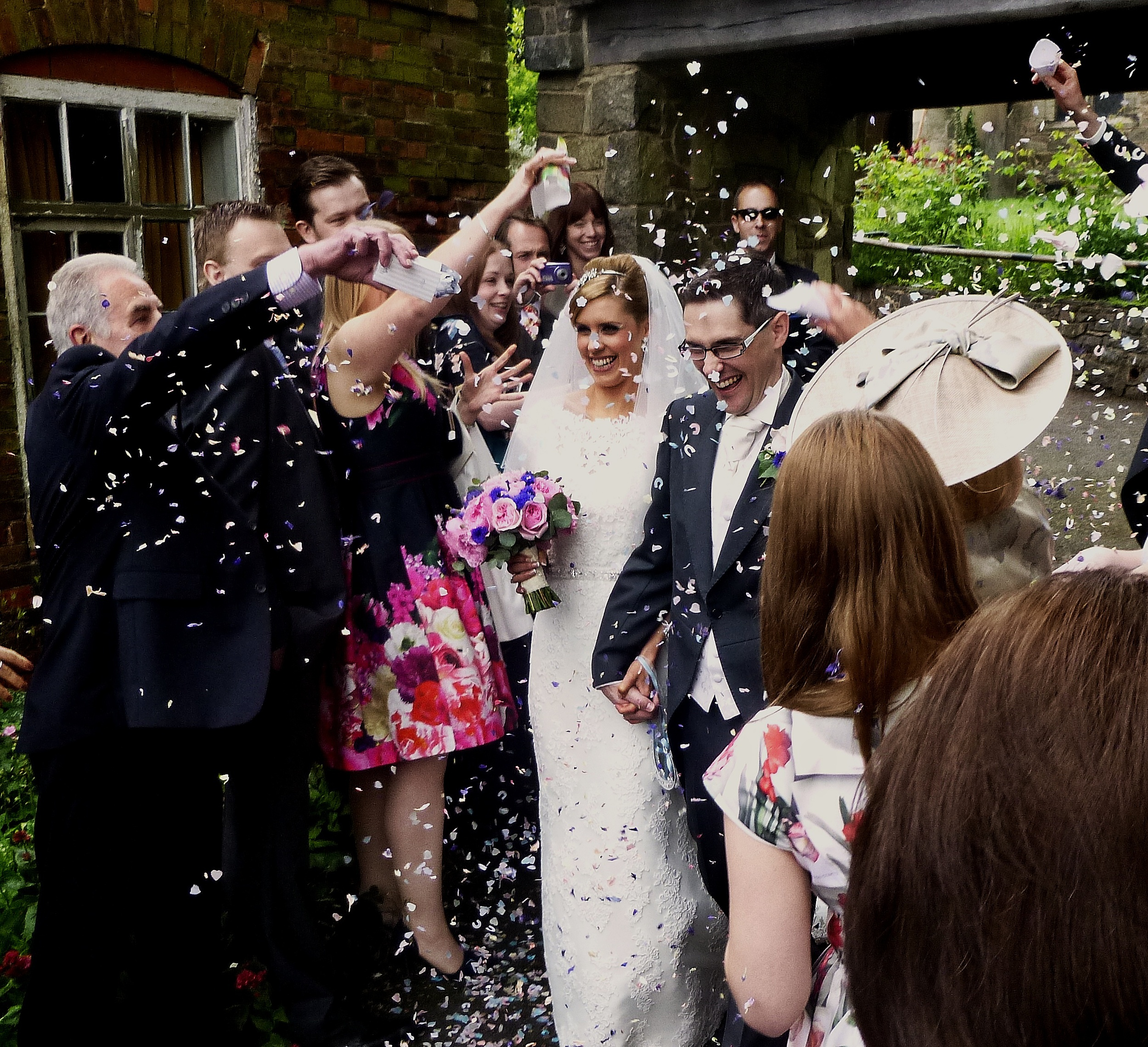 Amy and Jason looking so happy following their marriage at St Michael of All Angels, Markfield.