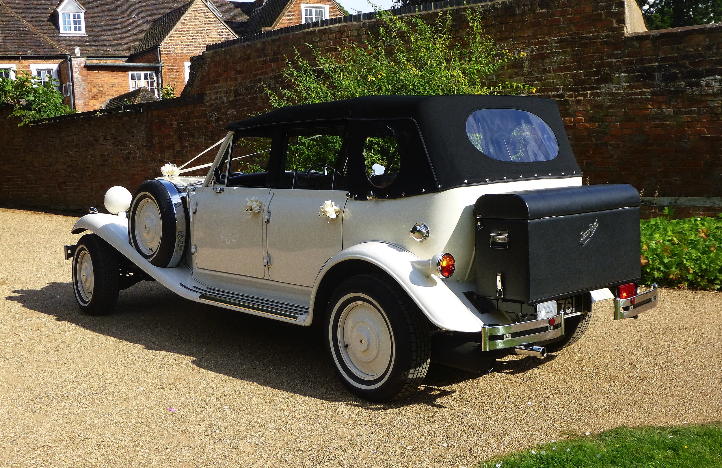 "I thought this was a useful image of the Beauford showing the very smart new hood. The passengers, Vas and Antony were taking part in a ""photo shoot"" in the village of Berkswell, Nr Coventry. We were on our way to the reception venue  at The Hilton, NEC. Earlier Vas and her Father had made the journey from Ashby de la Zouch to the Greek Orthodox Church in Coventry. Although a little late leaving we arrived ""almost"" on time thanks to kind traffic conditions on a Sunday afternoon. Our longest distance wedding of the year at 94miles. A good fun occasion!"