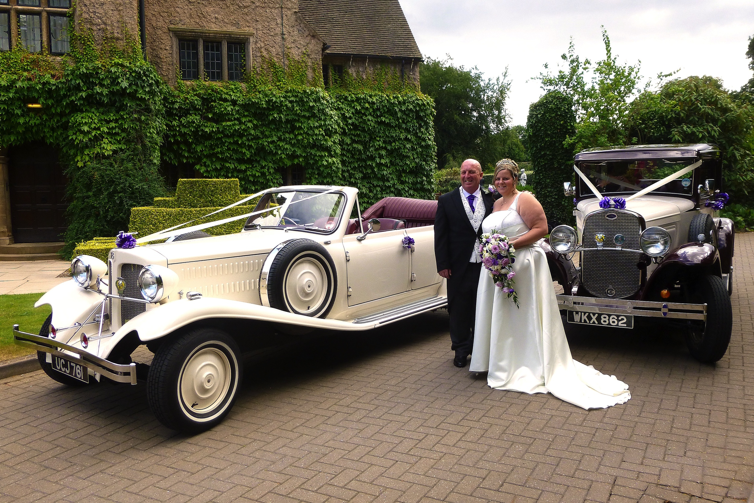 """Tara and Maurice pause for photos by the cars at Quorn Grange, following a lovely """"open top"""" drive around Quorn in the Beauford,"""