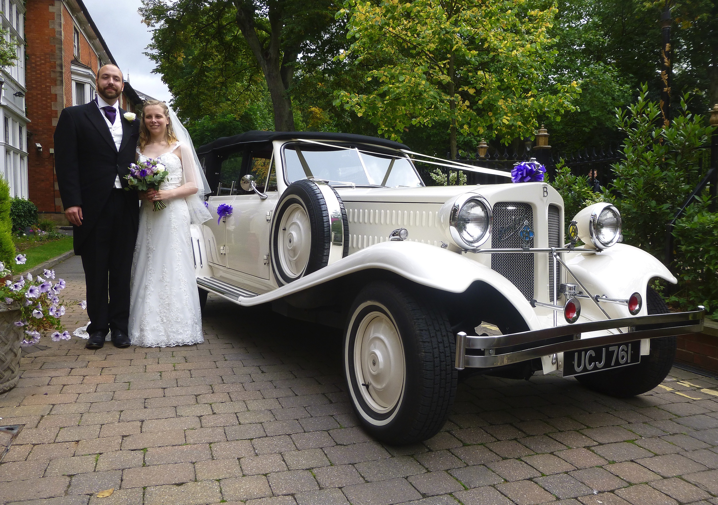 """Suzie and Oliver in a tranquil setting next to the New Walk at the Belmont Hotel, Leicester. """"Cadburys"""" purple is a popular choice of ribbon colour and gives a """"sparkle"""" to the Beauford."""