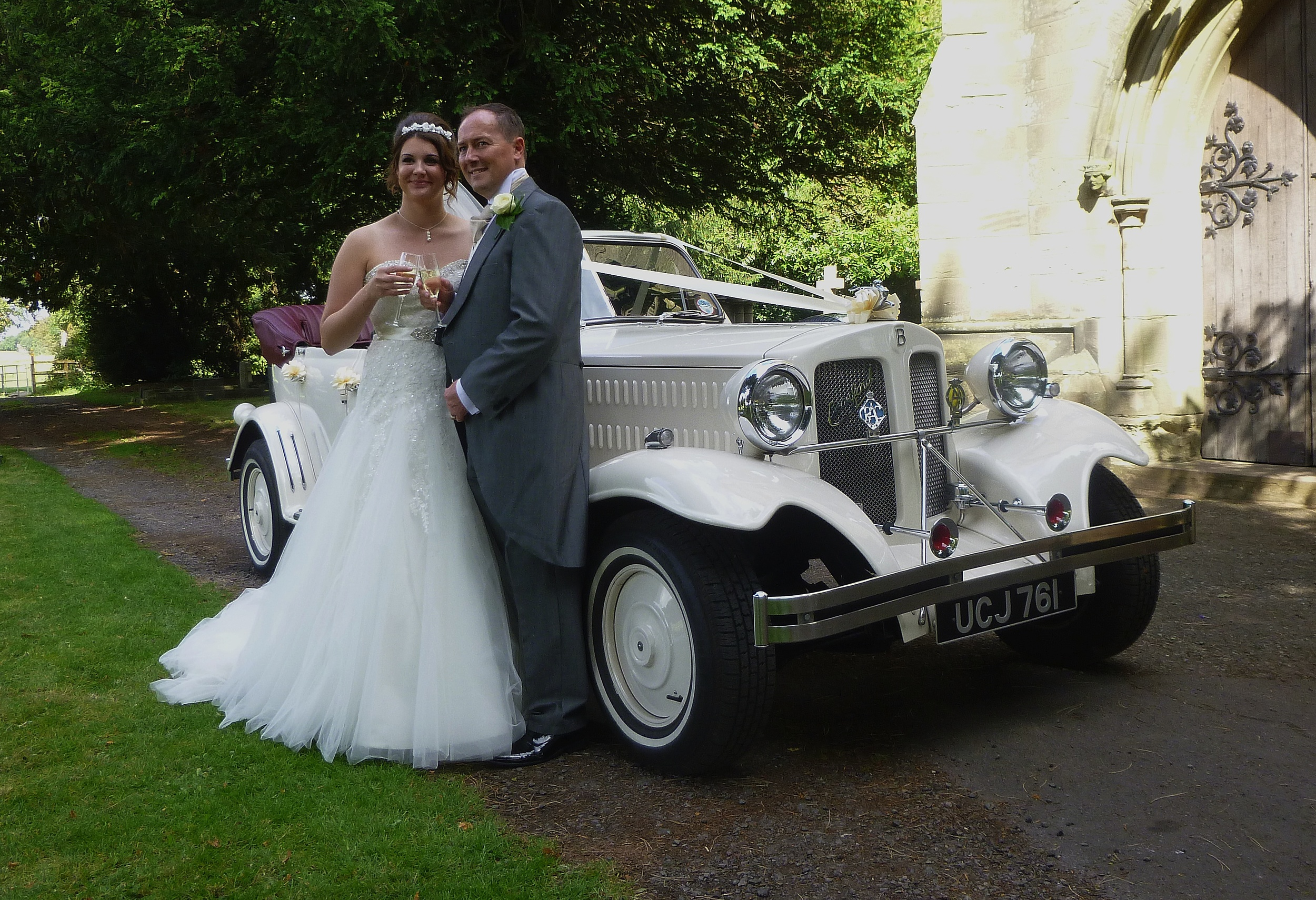 Danielle and Edward enjoying a toast following their wedding at St Jame's Church, Ansty, Coventry, Warwickshire.