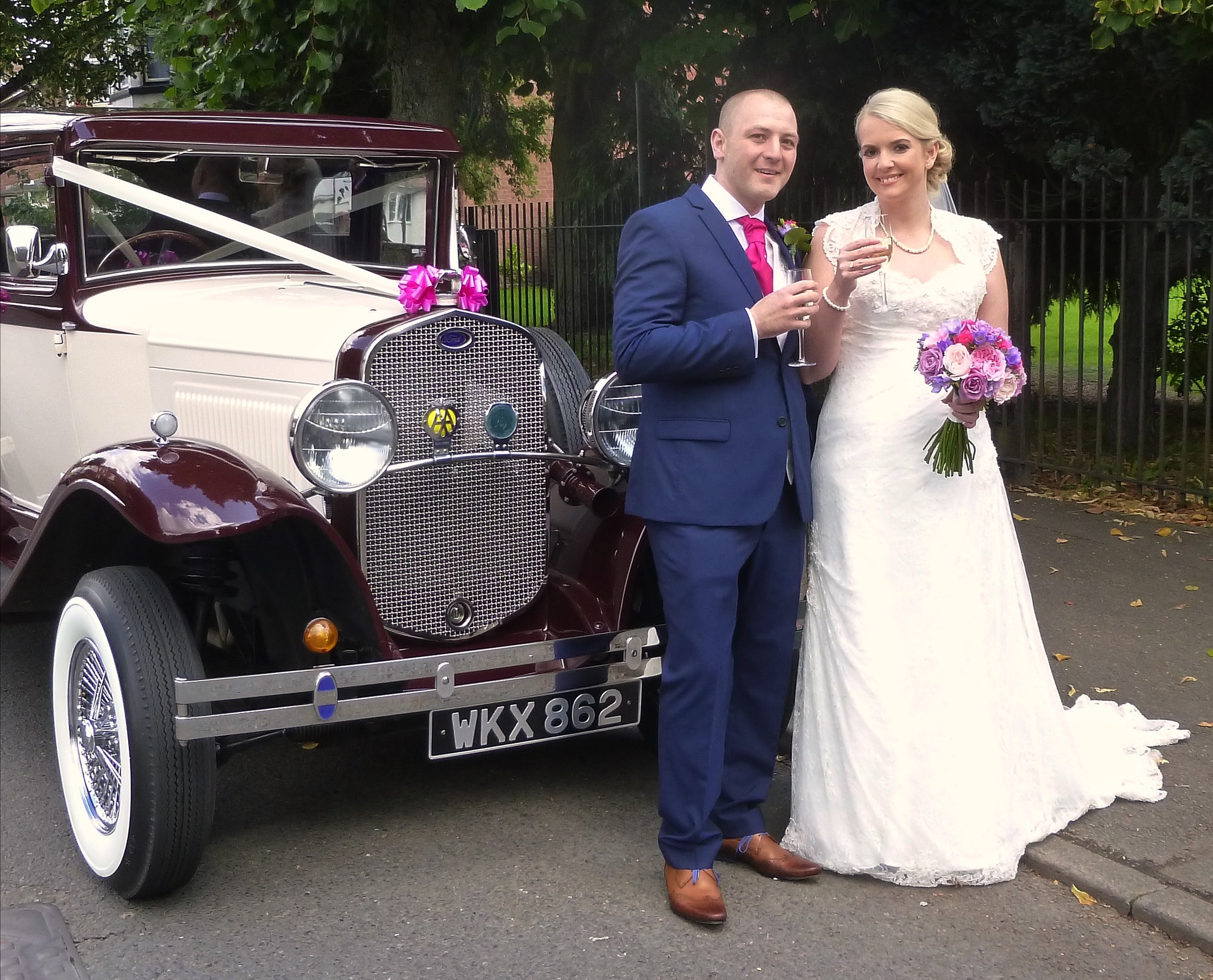 """Michelle and Chris enjoying a """"toast"""" prior to a drive around Nuneaton to their reception venue of the  Ambleside Sports Club . Congratulations from Married in Style!"""