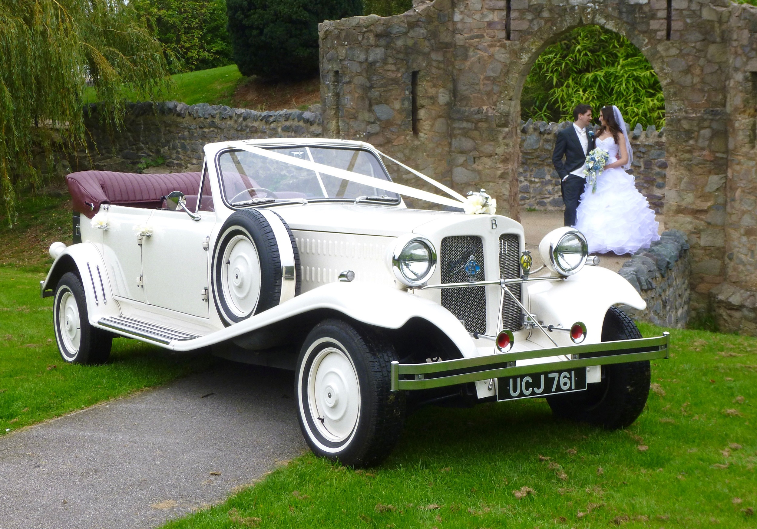 """Michelle and Charlie took full advantage of the ruins of Earl Shilton Castle for a photo shoot prior to leaving for their reception at  Ashton Lodge . Only a few yards with the hood down,a brief stop to pull the hood up and they were nice a warm for the journey along lanes to Street Ashton. We were greeted by the waiting guests on our """"showy"""" arrival, again with the hood lowered. A great occasion."""