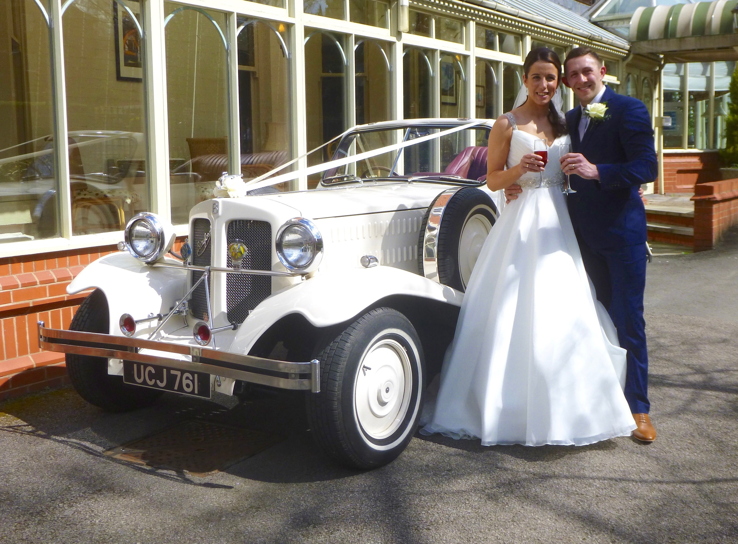 What a change from snow earlier in the day. Kimberley and Daniel enjoying a toast prior to an open top drive in the Beauford. Our best wishes to the happy couple. We really enjoyed playing a small part in the occasion.