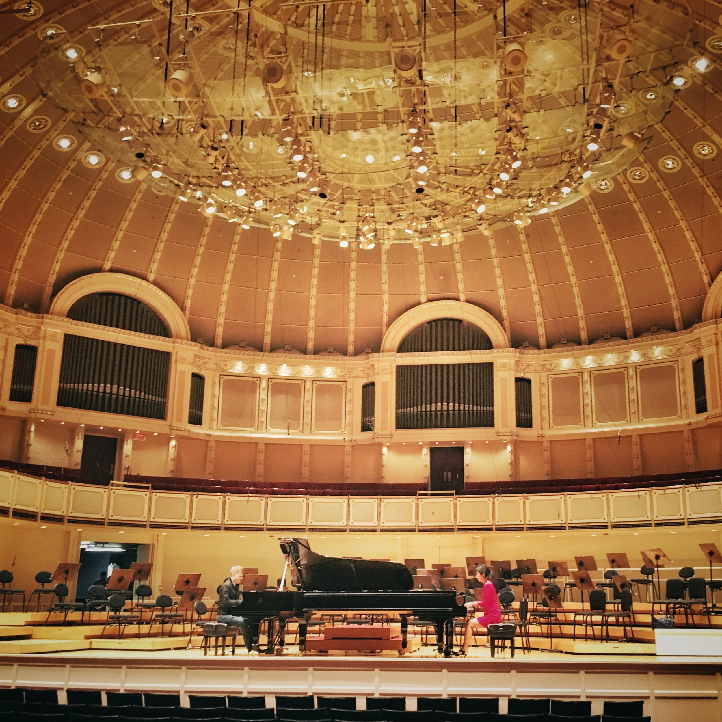 rehearsing on the storied stage of Orchestra Hall in Chicago