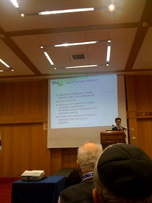 Alex Masychef of WritePoint presenting SmartDocs - a content reuse solution for MS Word. Nadina Rosentuler behind the iPhone camera.