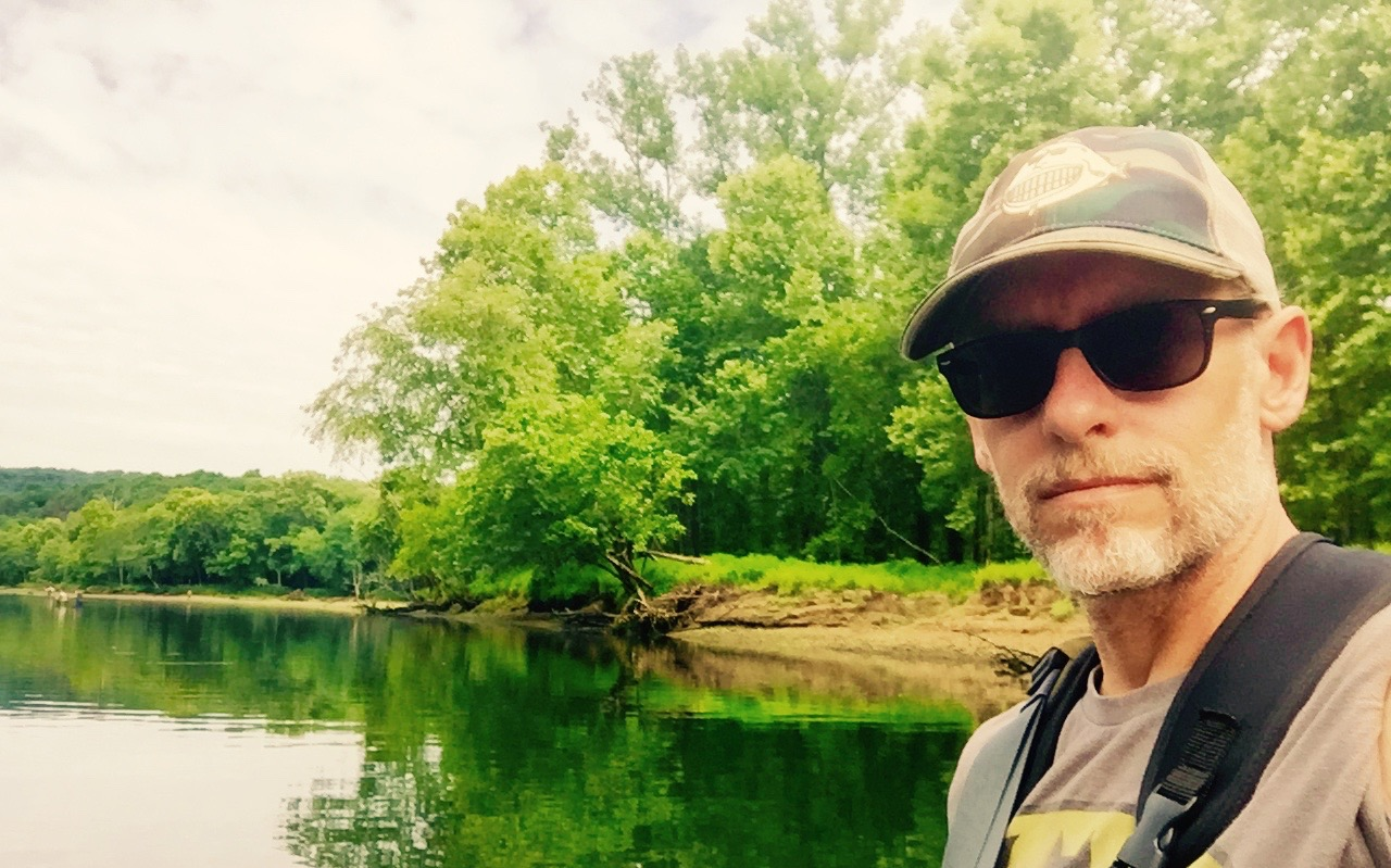 Troy Thomas (founder of Fish Face, a brand of outdoor clothing) fly fishing the Caney Fork