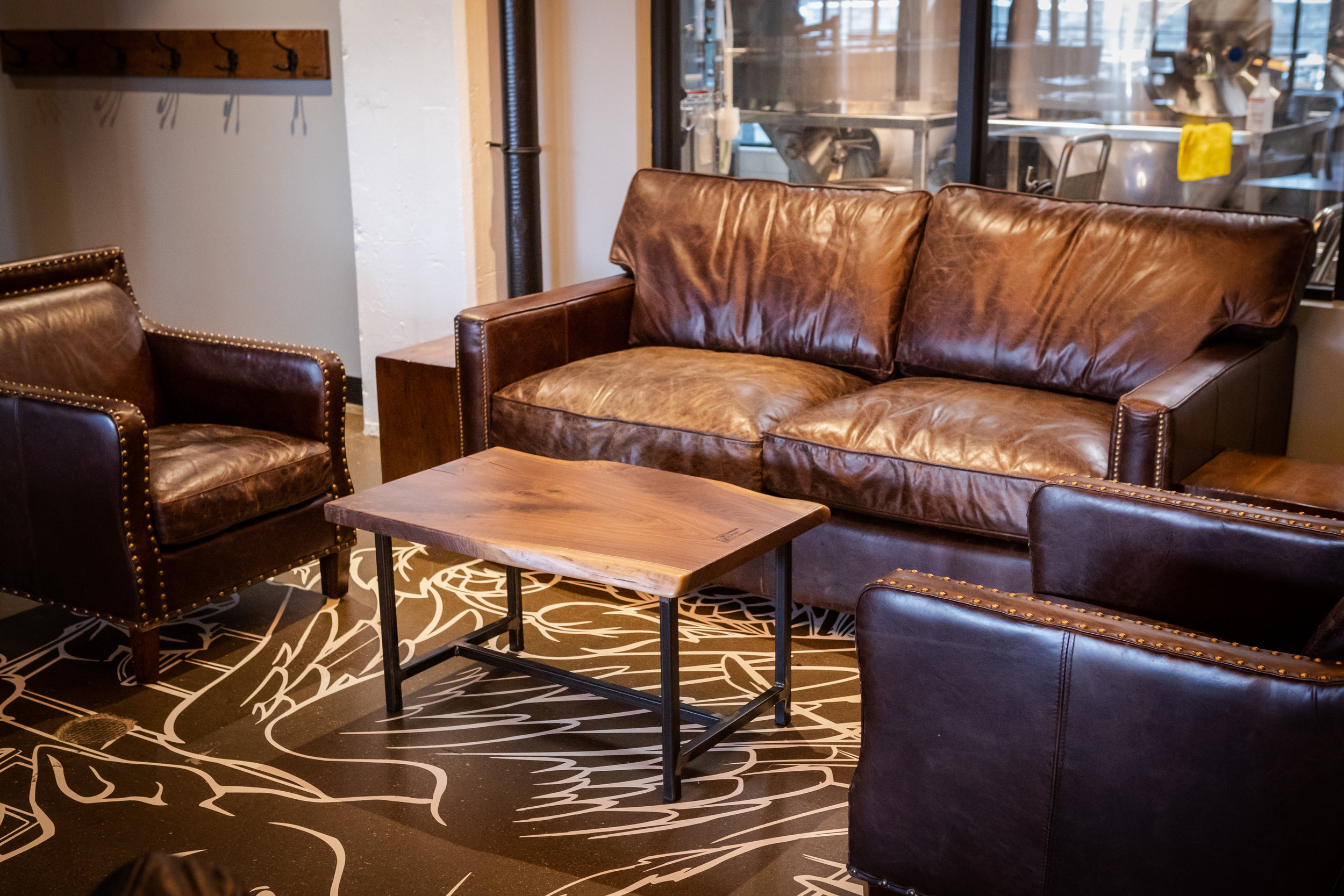 """Larkin Sofa Sofa-  Showin in 72"""" in cigar leather. Also available in 88"""" in the cigar leather as well as rider black leather. Chair and sectional options also available .    Alcott Leather Chair-  shown in cigar leather with nailheads (only option)."""