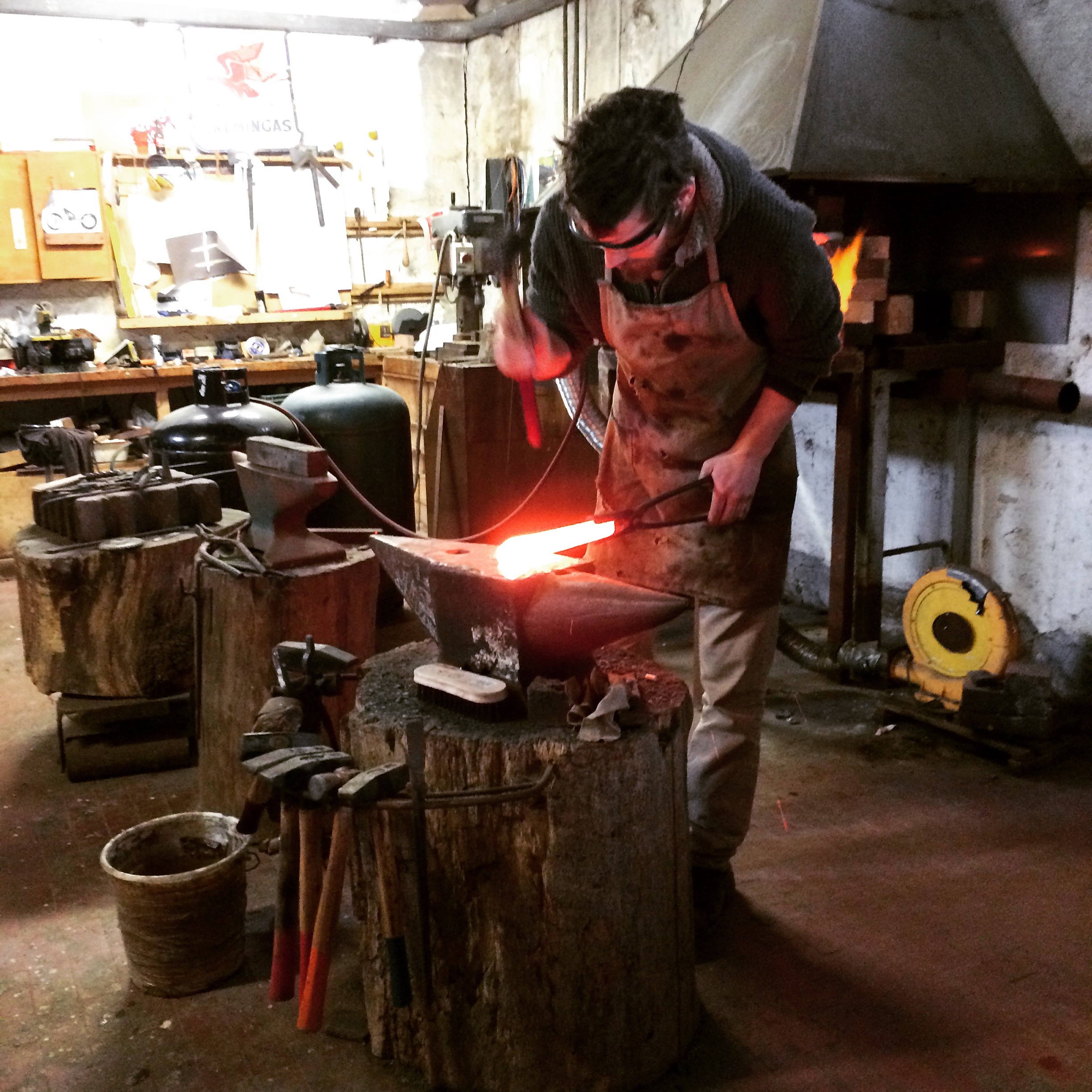 blacksmith forging knives