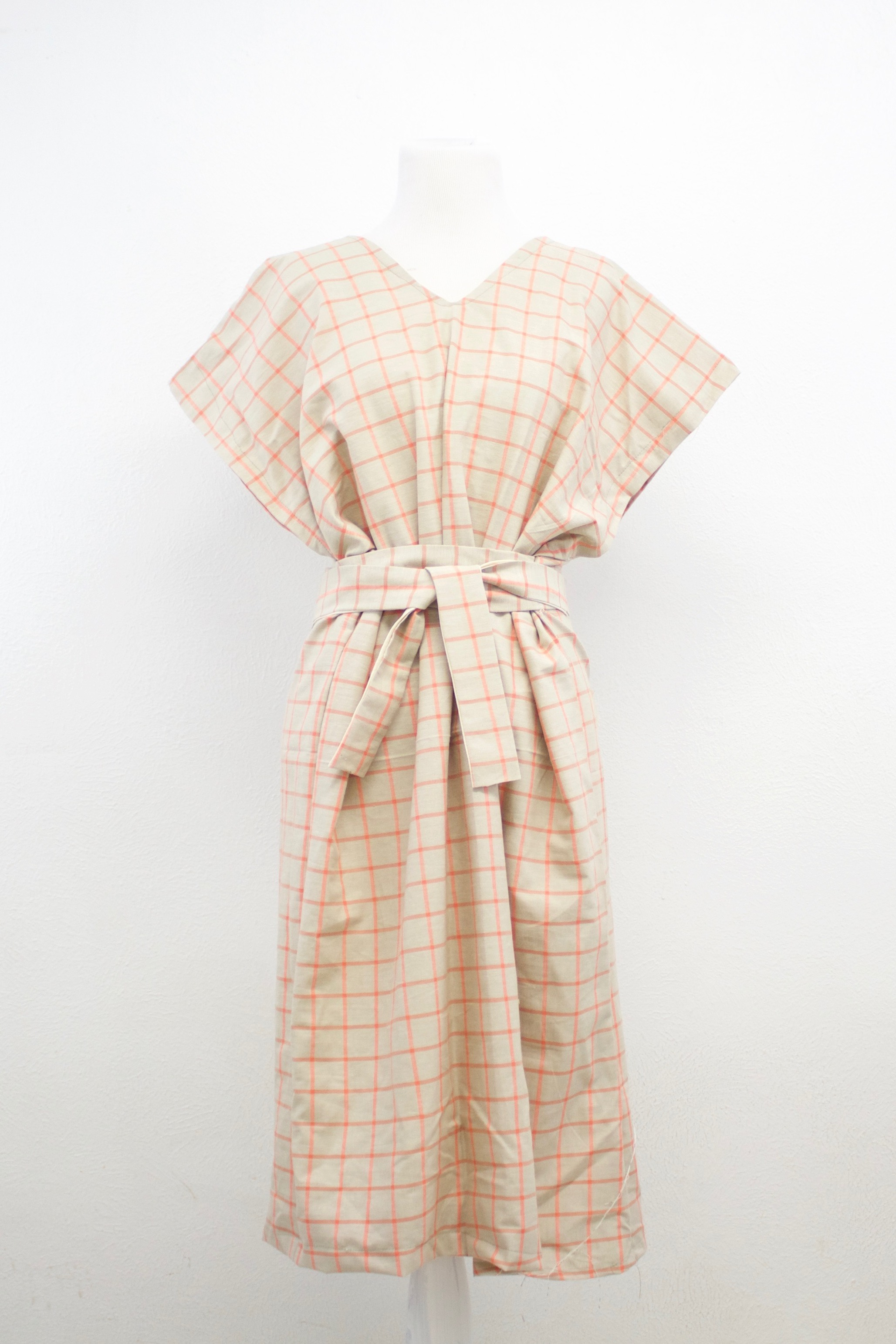 - Peach Grid Dress | $79.99
