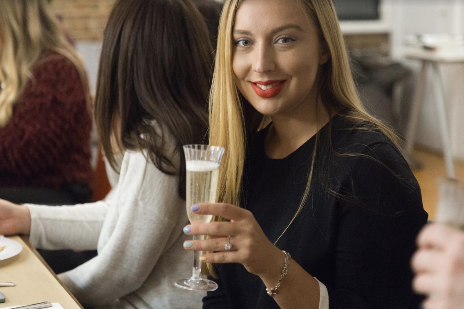 @sofiaecha  enjoying a glass of champagne.