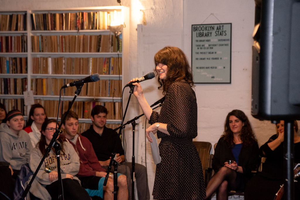 Kat reading her essay at our Burn The Book premiere on April 19. Photo by Bridget Haggerty.