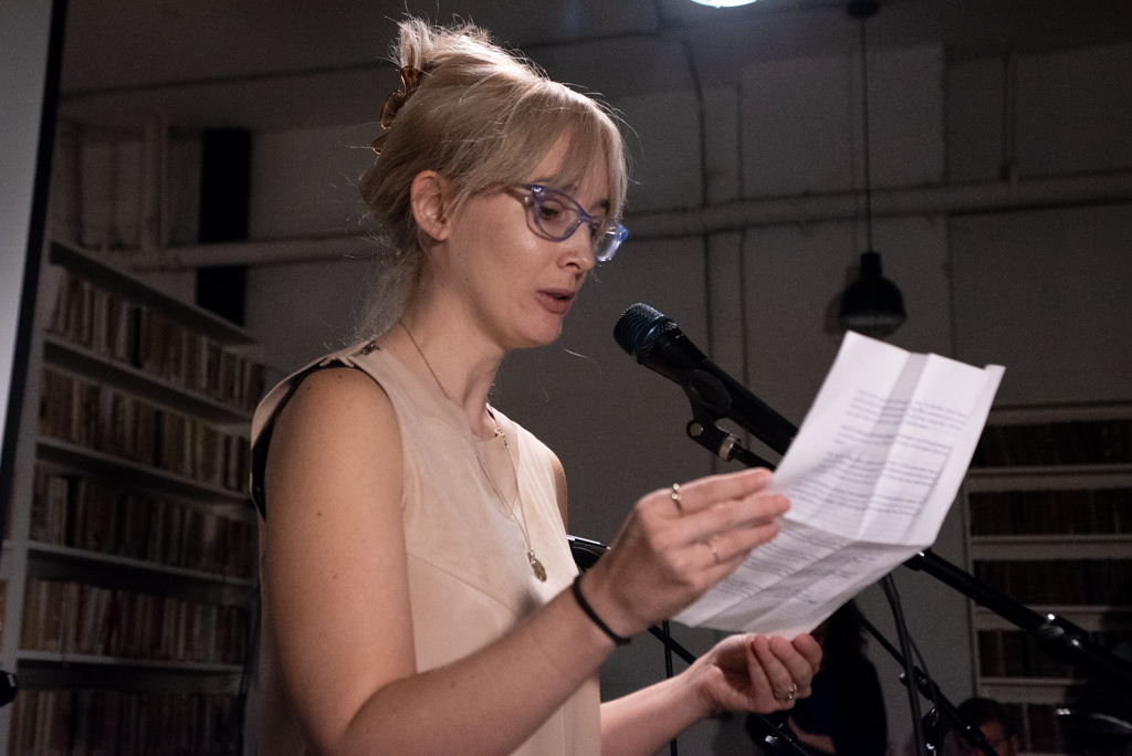 Jenny reading her essay at the Burn The Book premiere on April 19. Photo by Bridget Haggerty.
