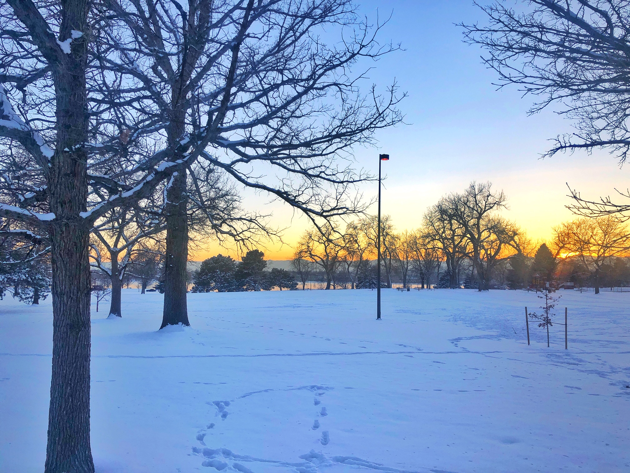 Snowy sunset views from Sloans Lake.