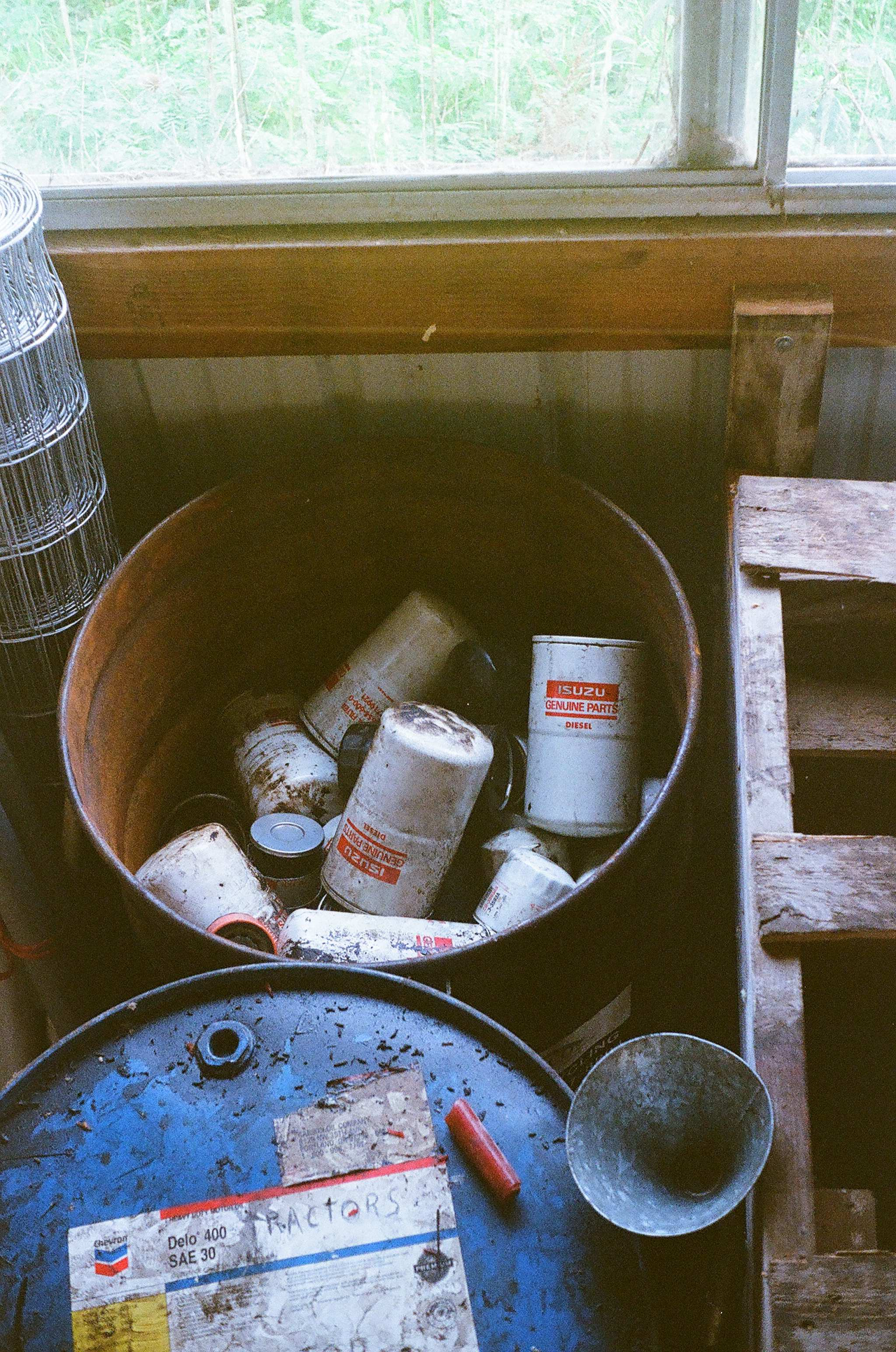 Used oil filters are stored in a barrel before being transported to a Portland company that separates and recycles the steel, paper, and oil in the filters. It takes ten years to fill this barrel!