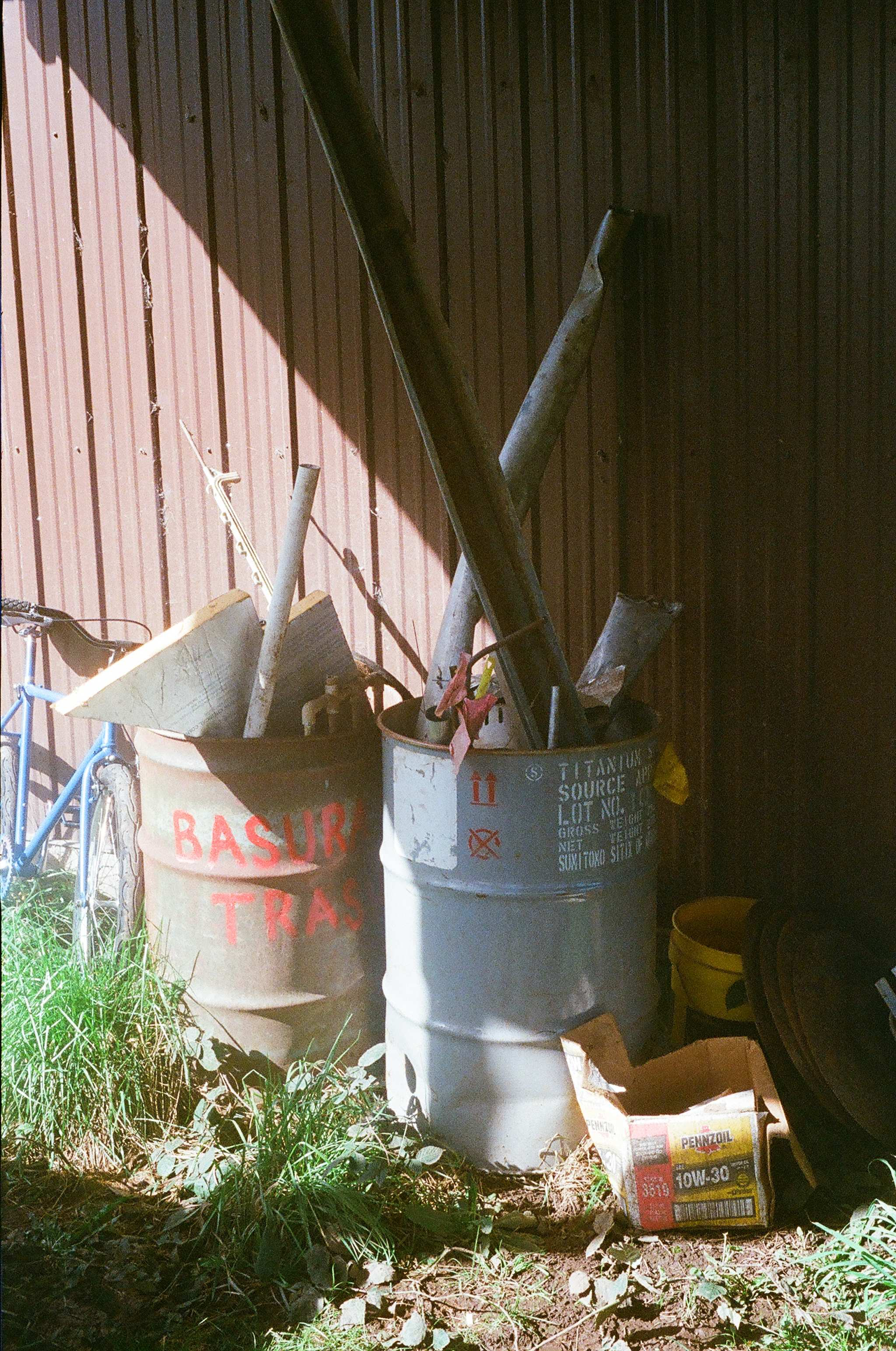 Used metals are stored in barrels and taken to a junkyard annually for recycling.