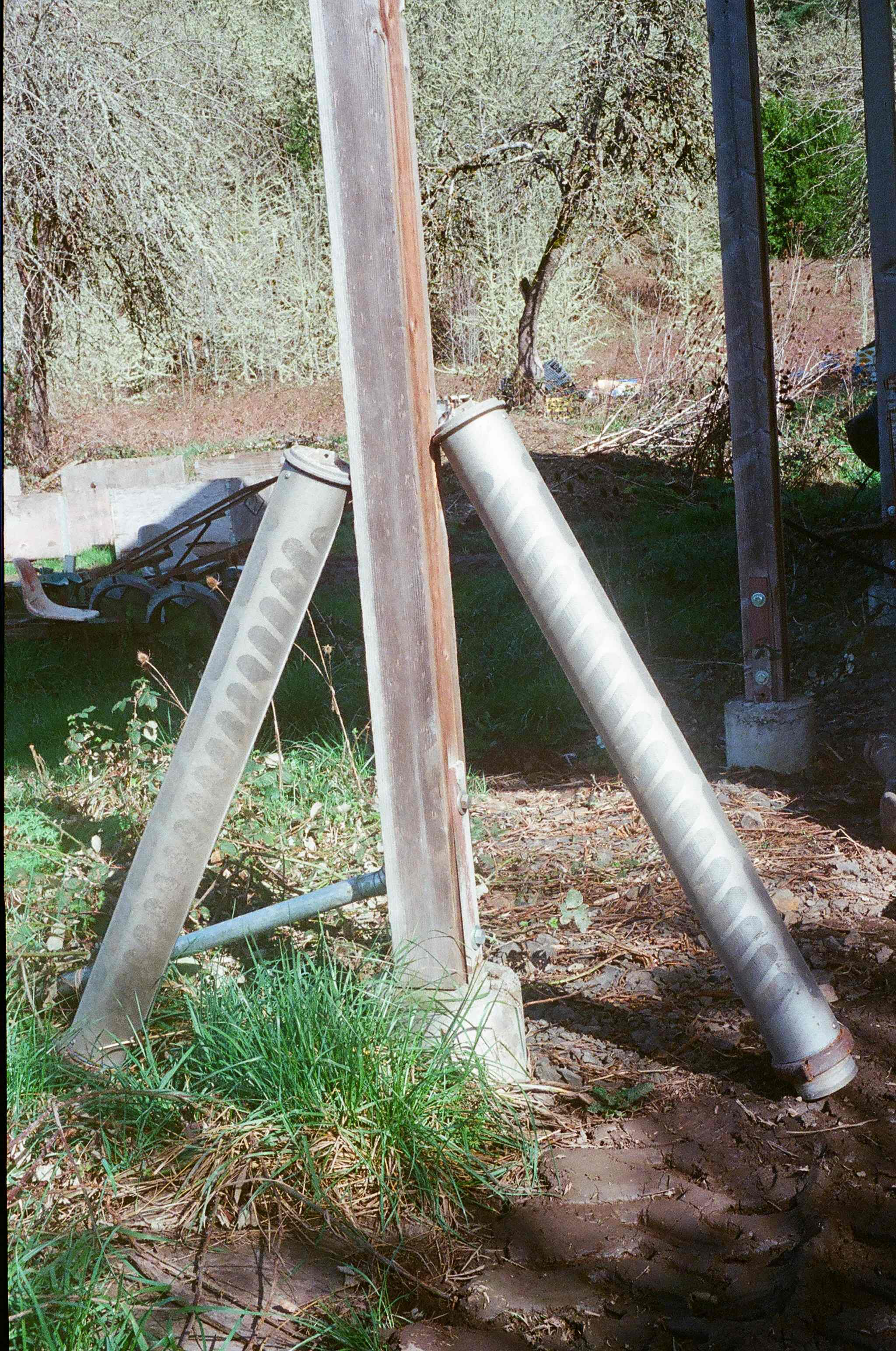 The two cylinders leaning against the post are fish screens that we use on our irrigation pump intake to keep fish of all sizes from getting sucked into the irrigation system.
