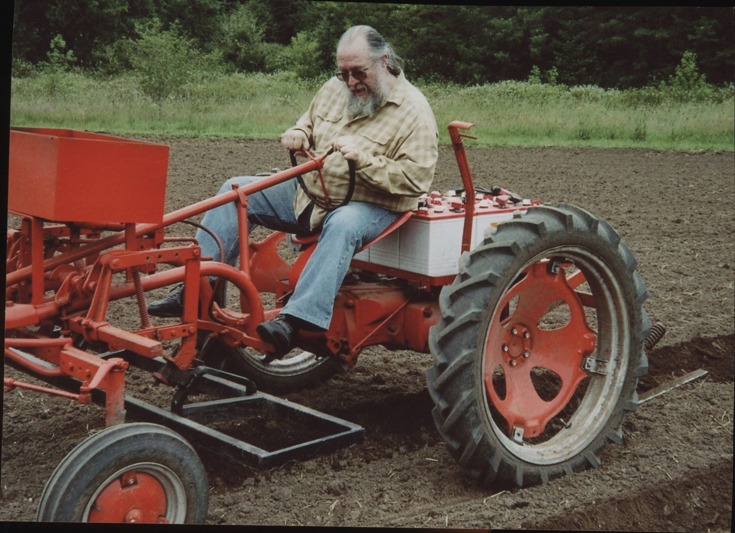 Dad drives the electric tractor.