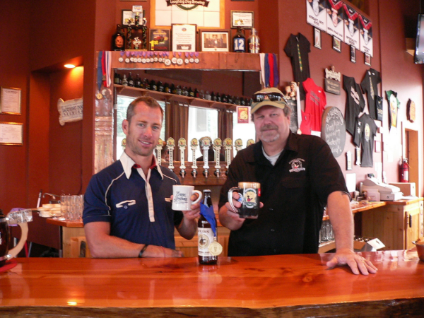 Rick Evans celebrates with Fred Colby, Owner of Laughing Dog Brewing
