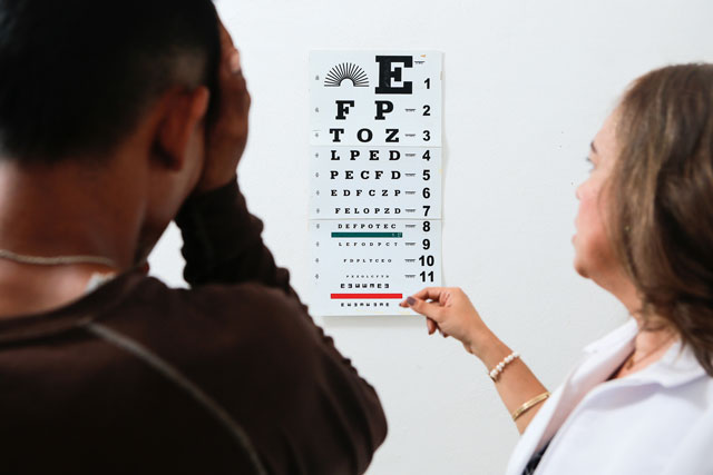 A Campos Borquez employee (left) is treated by an optometry center employee.  Download high resolution image here.