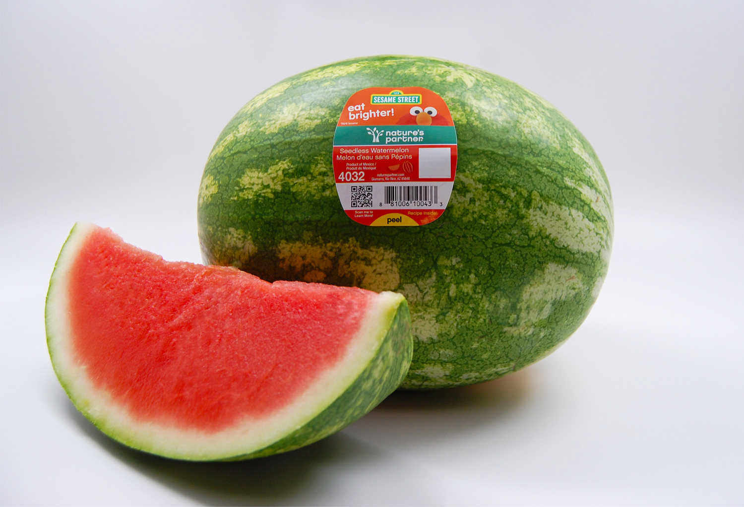 Nature's Partner watermelon featuring Elmo of  Sesame Street .  Click here to download high resolution image.